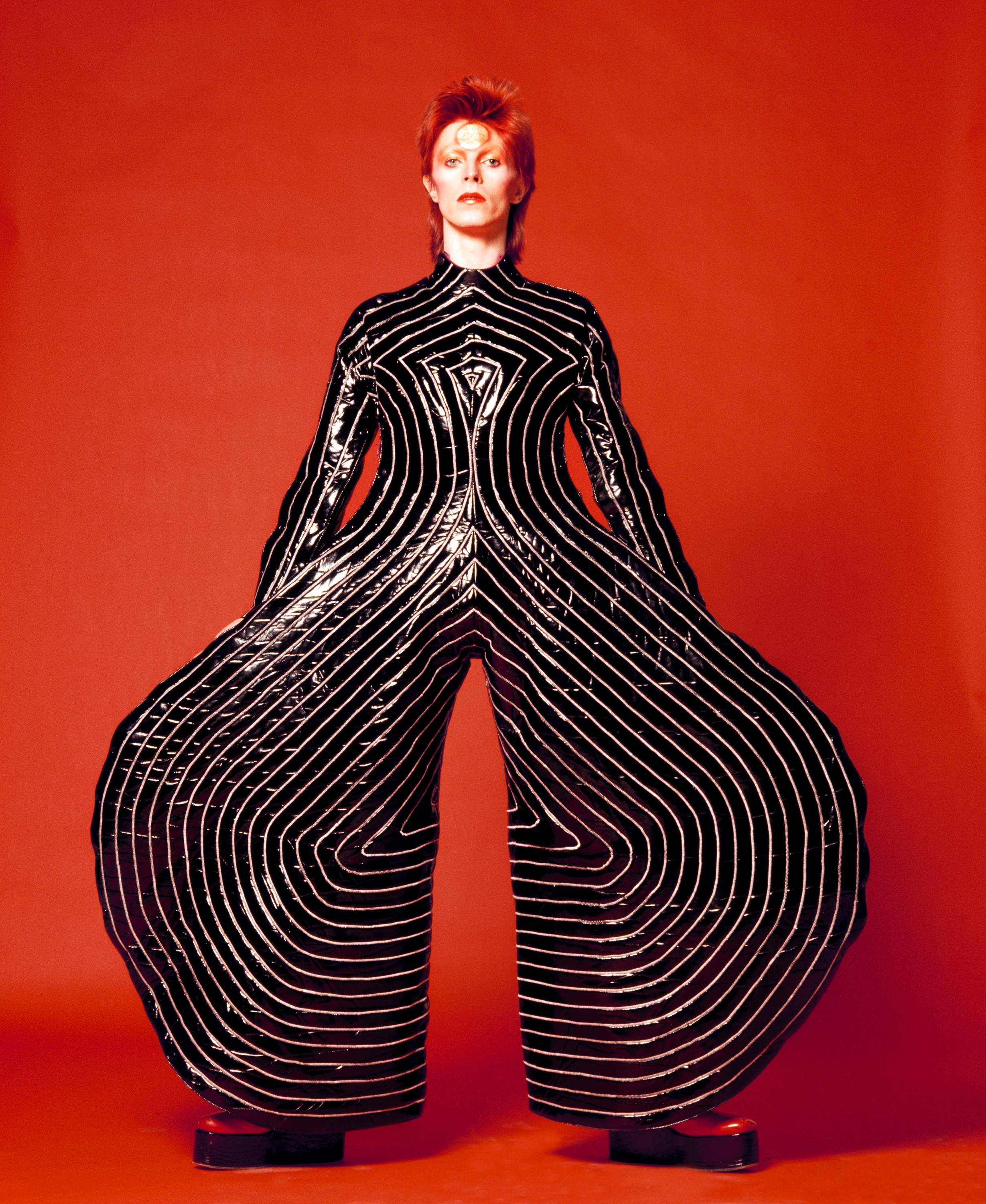 "The striped bodysuit for David Bowie's ""Aladdin Sane"" tour in 1973 epitomizes the musicians's over-the-top glam period, explored in the ""David Bowie Is"" exhibit at the Museum of Contemporary Art starting Tuesday, Sept. 23."