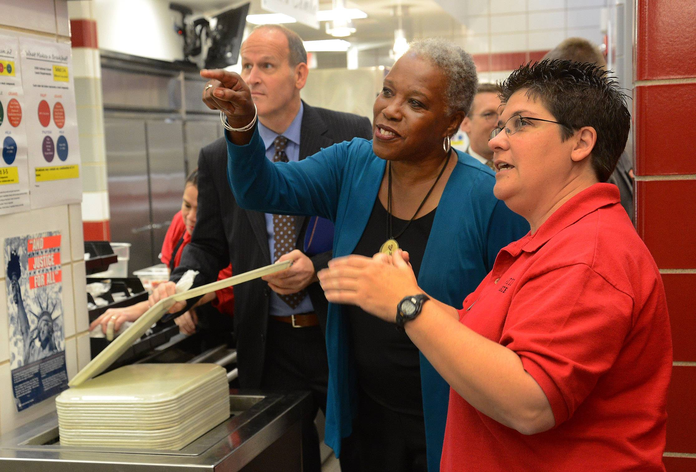Audrey Rowe goes through the lunch line guided by Food Service Manager Debbie Madaj.