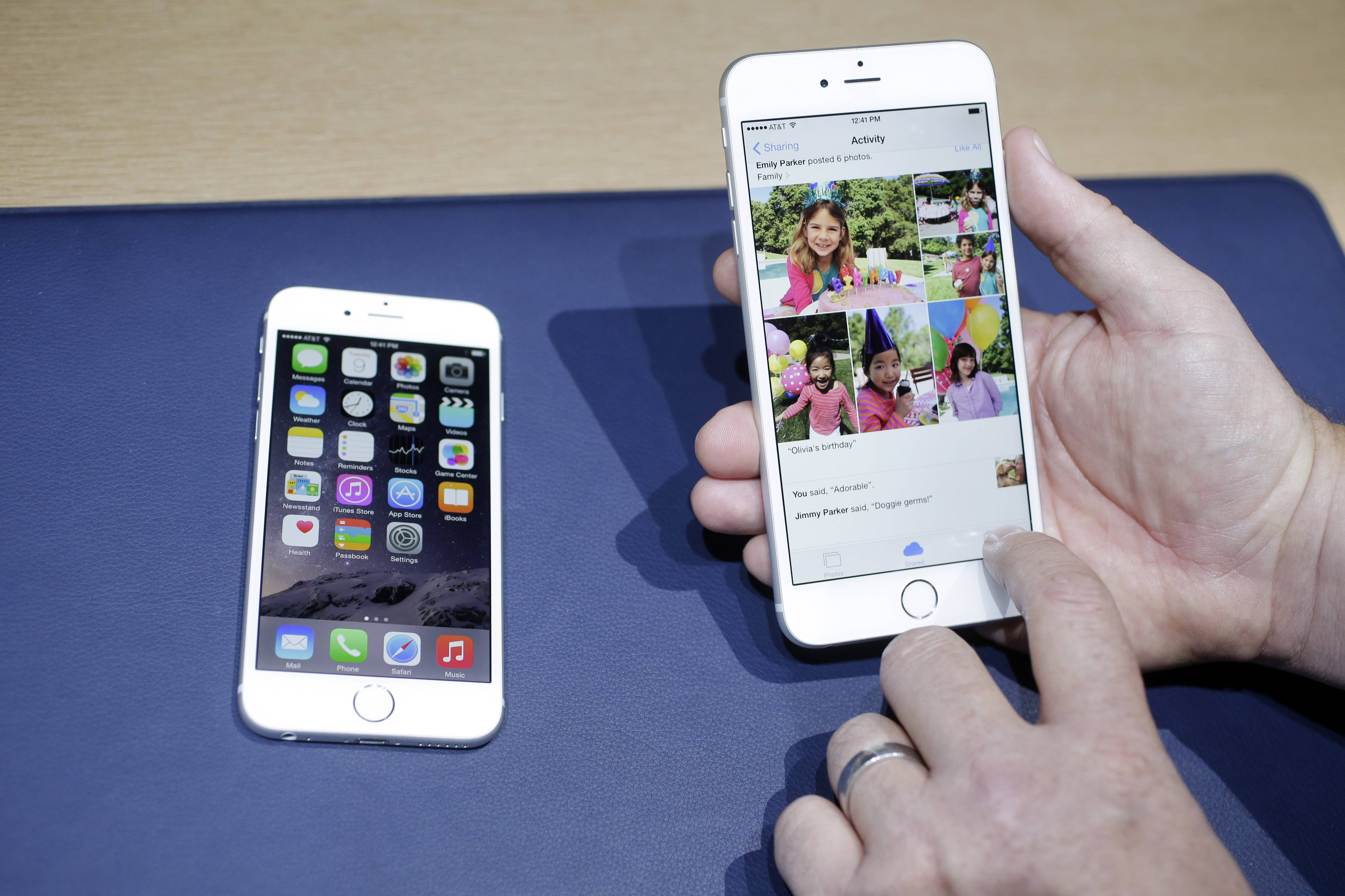 The iPhone 6, at left, and iPhone 6 plus are shown next to each other during a new product release in Cupertino, Calif. Apple's new and bigger iPhone 6 and iPhone 6 Plus are more durable than last year's model and a leading Android phone, a study says.