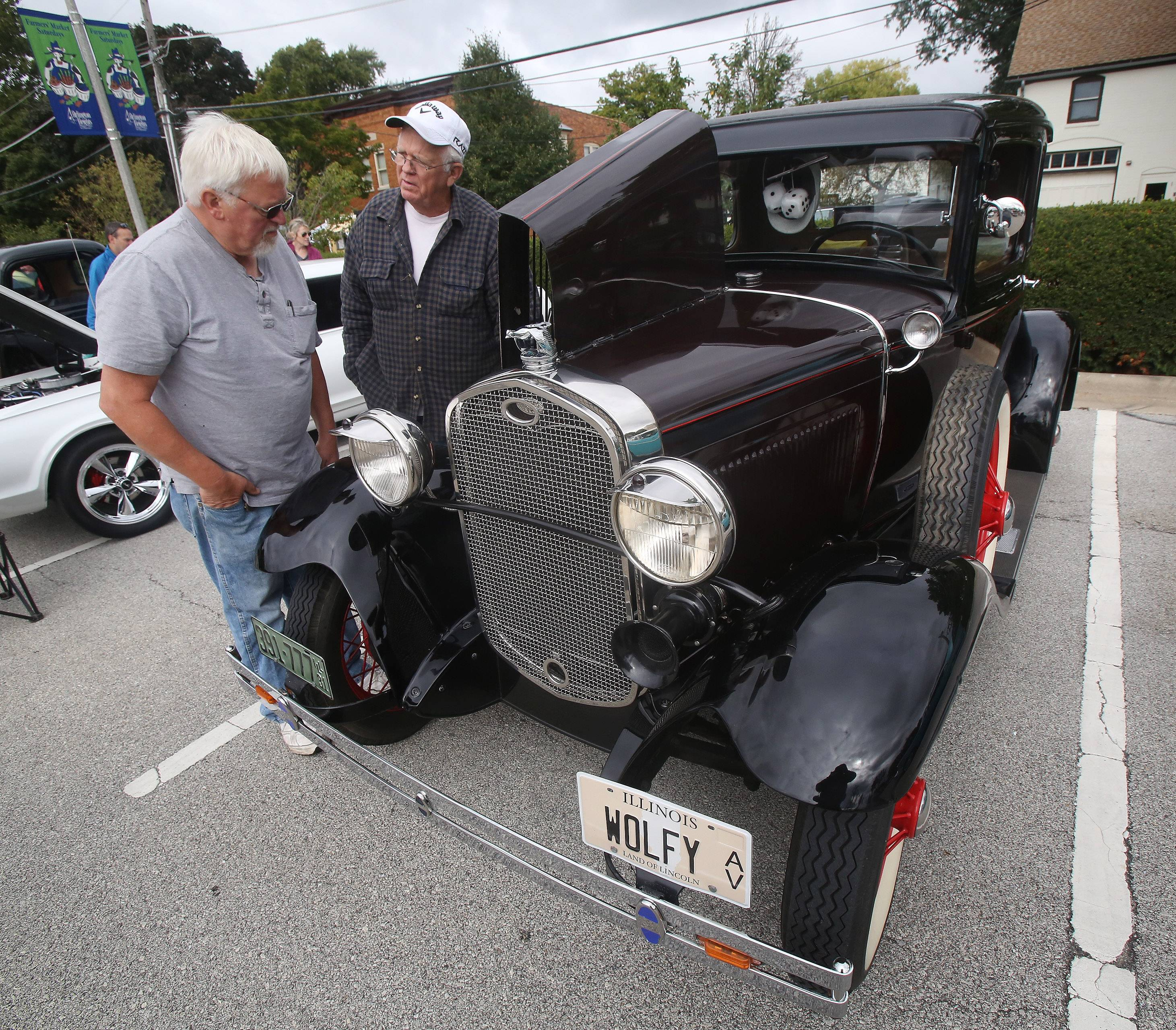 Chuck Parcell of Mount Prospect, left, and John Murphy of Prospect Heights talk about the 1931 Model A Ford Coupe on display Sunday during the 3rd annual Motoring at the Museum Car Show at the Arlington Heights Historical Museum. The show featured over 100 antique, muscle, foreign and customized cars.