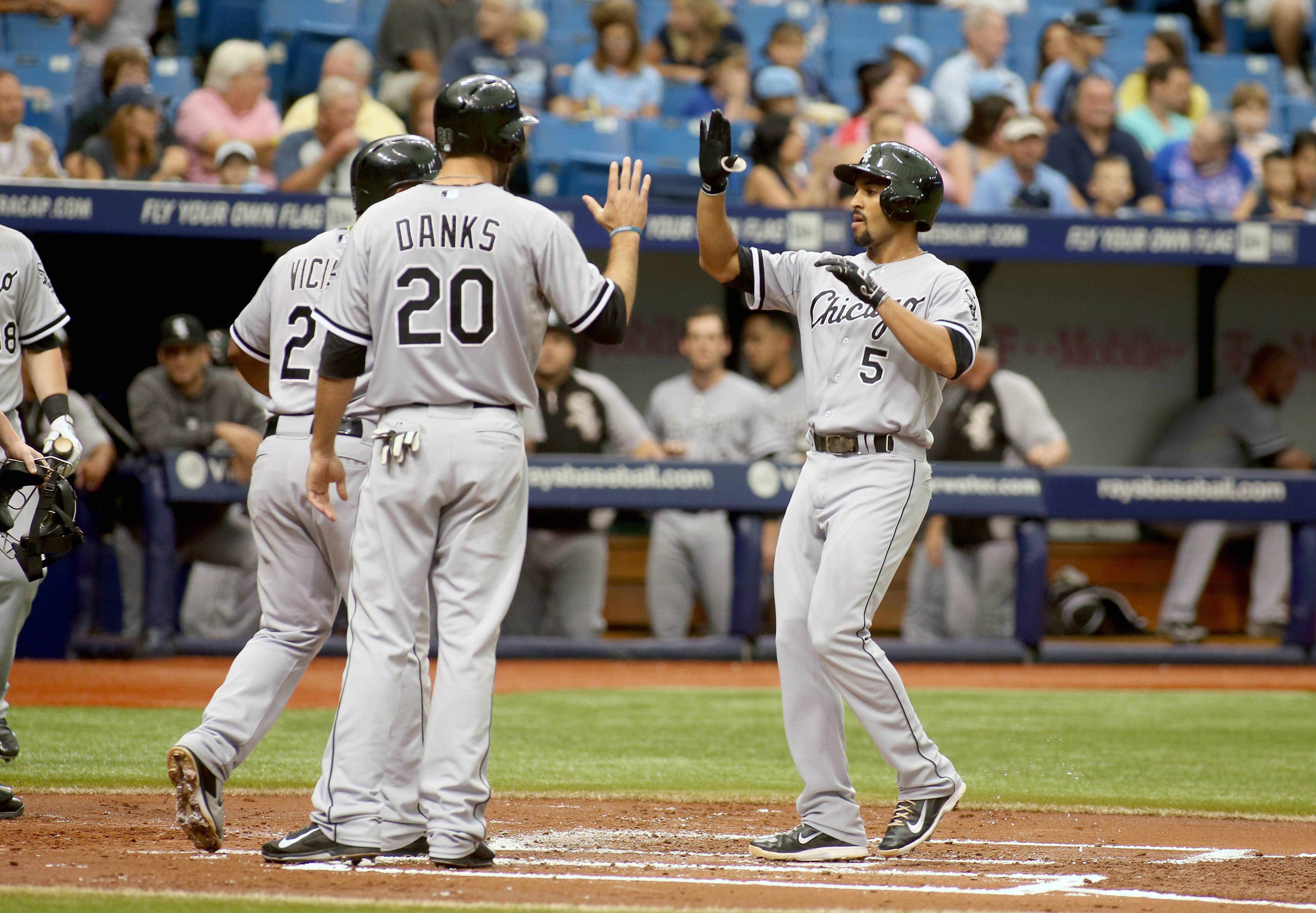 Chicago White Sox third baseman Marcus Semien (5) gets congratulated on his three run home run by teammates Jordan Danks (20) and Dayan Viciedo (24) during the second inning of a baseball game against the Tampa Bay Rays on Sunday, Sept. 21, 2014 in St. Petersburg, Fla.