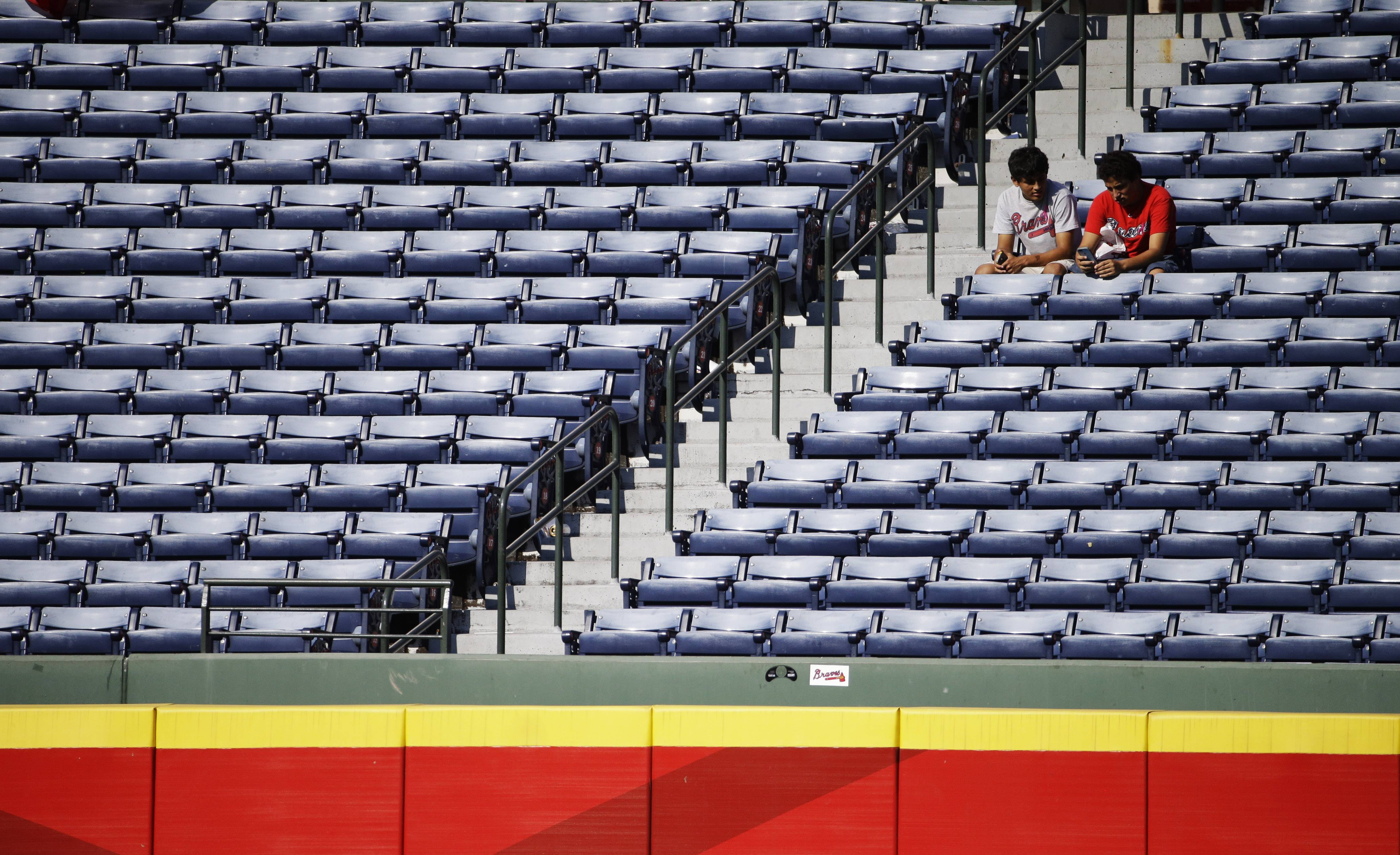 Much like these Atlanta Braves fans willing to stick by their team, Chris Rongey doesn't want to see the baseball season end.