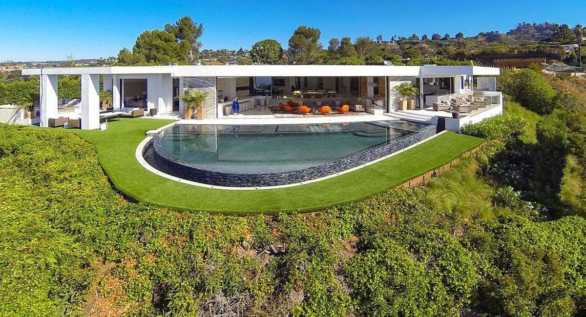 The eight-bedroom, 15-bath Beverly Hills, California, mansion has $5,600 toilets, a wall of caramel onyx and an 18-seat screening room with doors clad in Italian lizard skin. Asking price: $85 million.