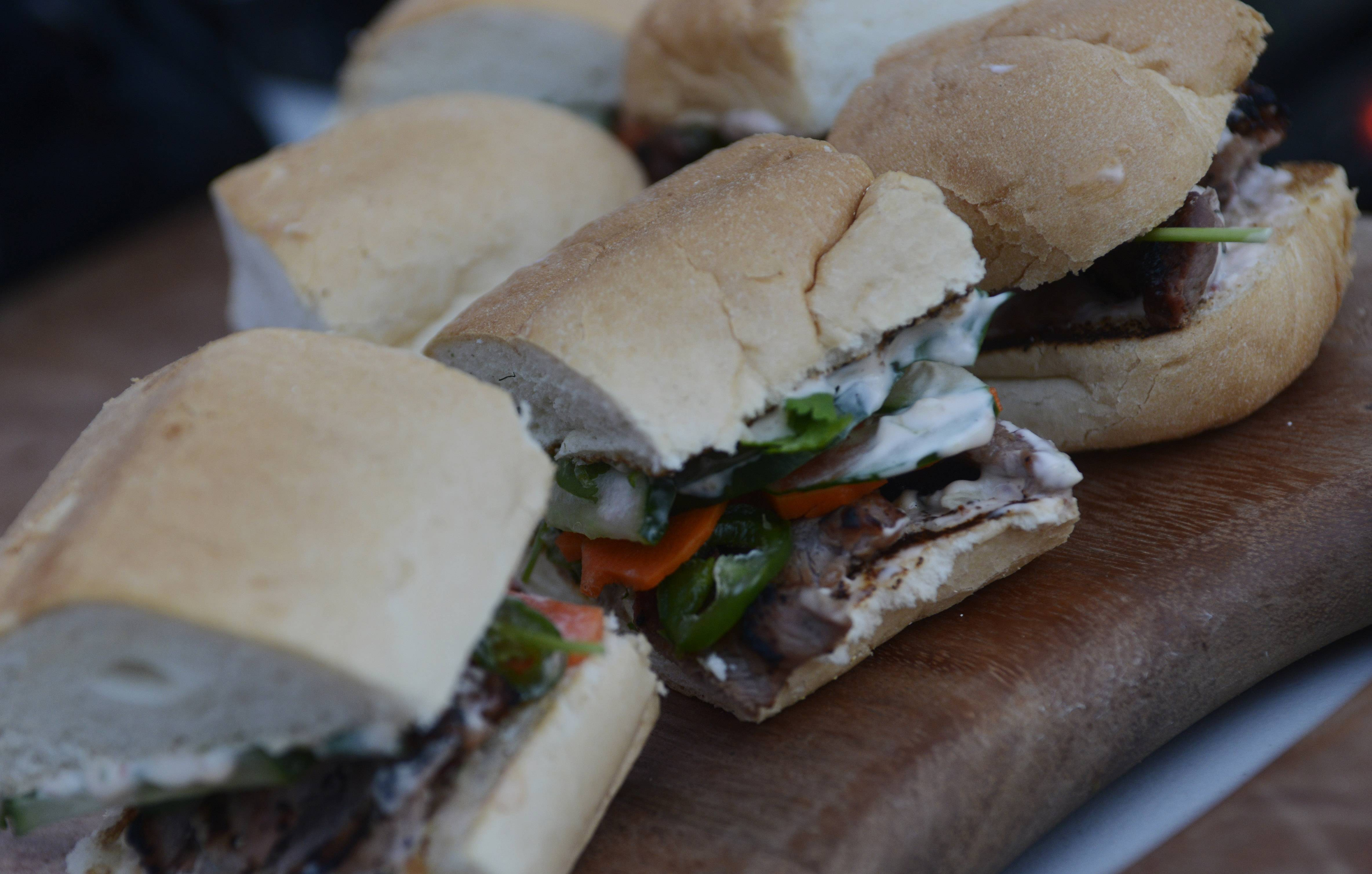 Korean-style pork sliders topped with pickled vegetables will score points with guests at football tailgate parties.