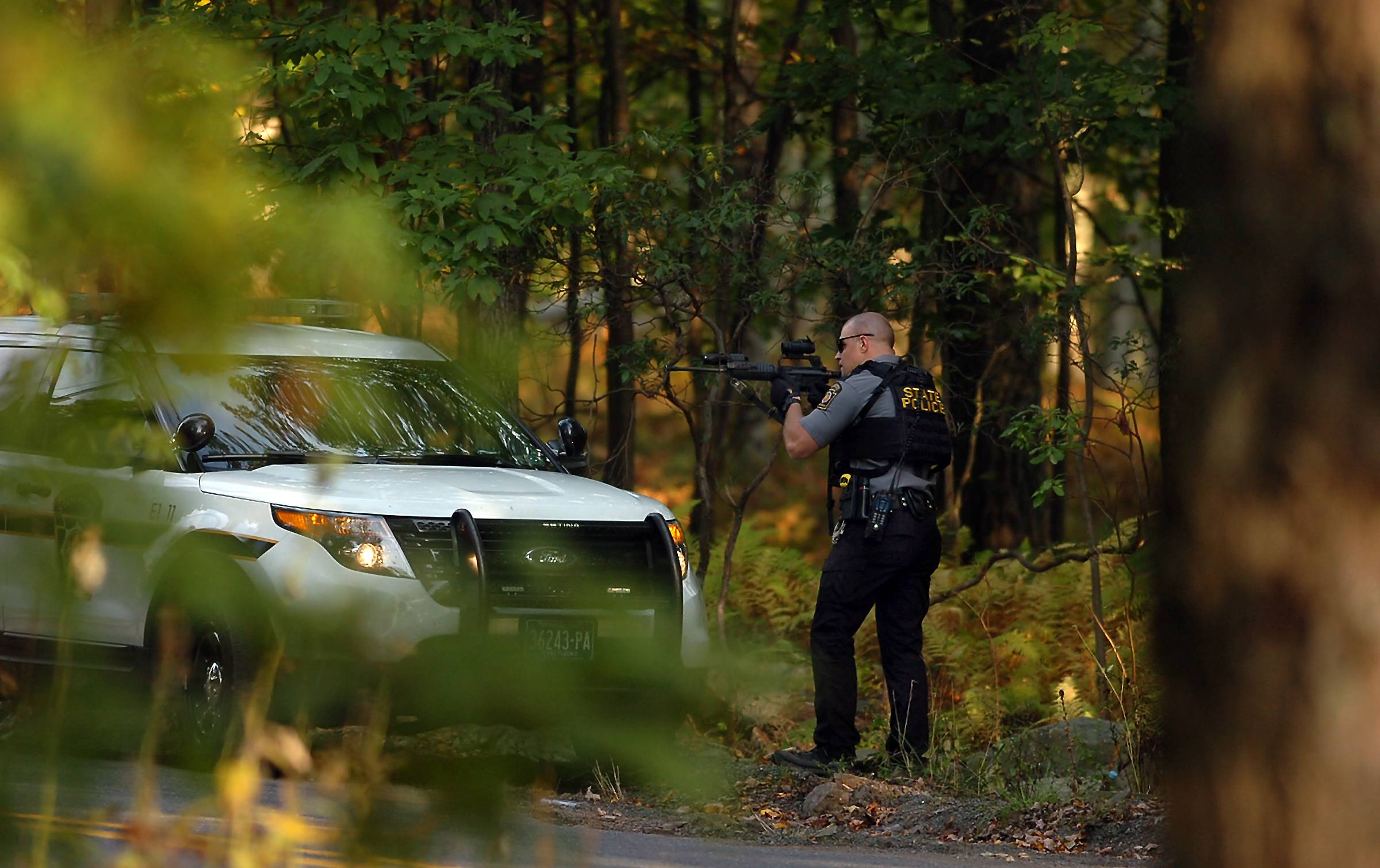 A 10-day manhunt for Eric Frein, the survivalist accused of ambushing a Pennsylvania State Police barracks, has narrowed to the rural area where he grew up and his parents still live, but the suspect has managed to elude capture despite the efforts of hundreds of law enforcement officials.