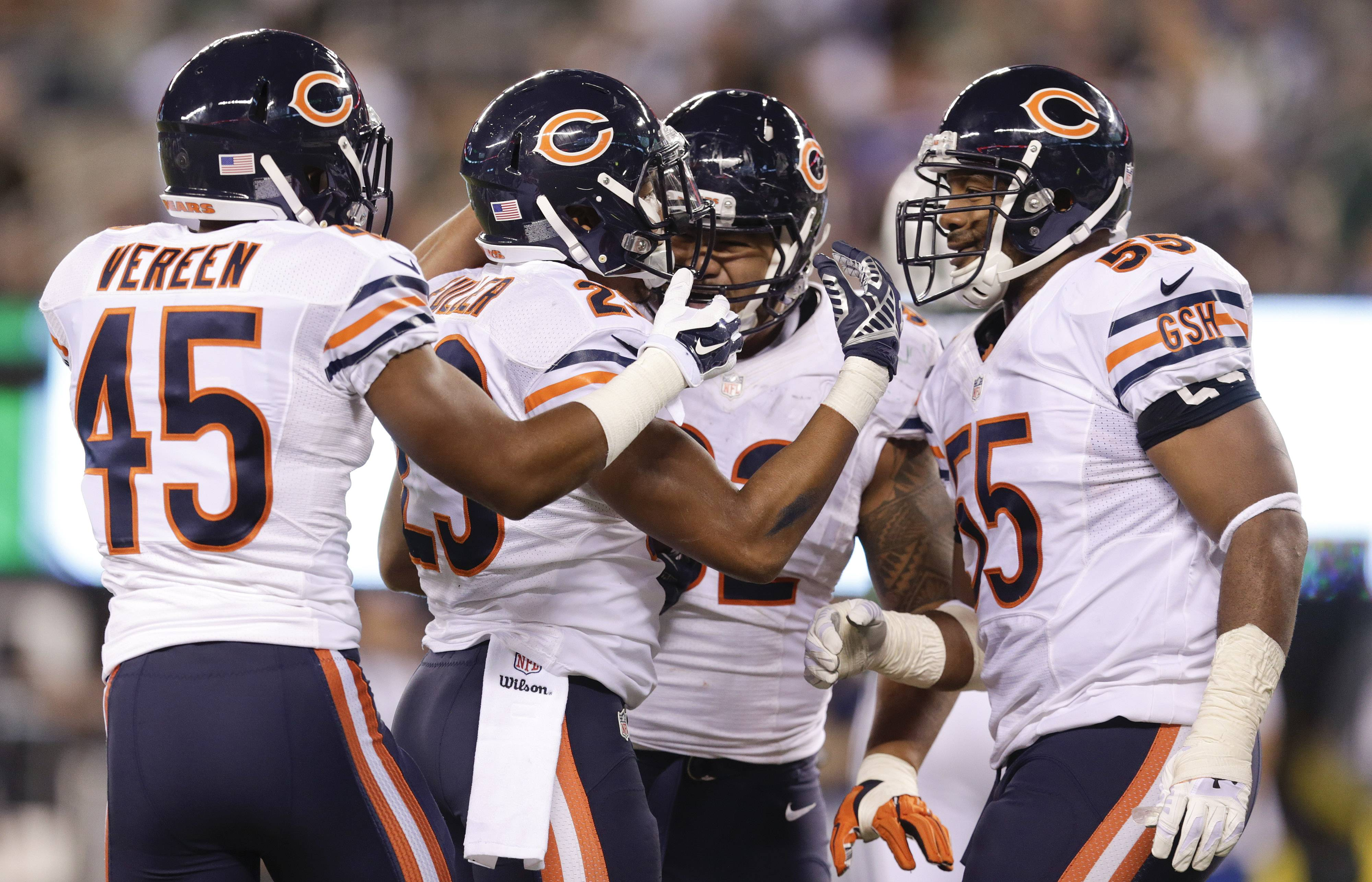 Bears cornerback Kyle Fuller celebrates with teammates after intercepting a pass in the end zone Monday night against the New York Jets. It was Fuller's league-leading third interception.