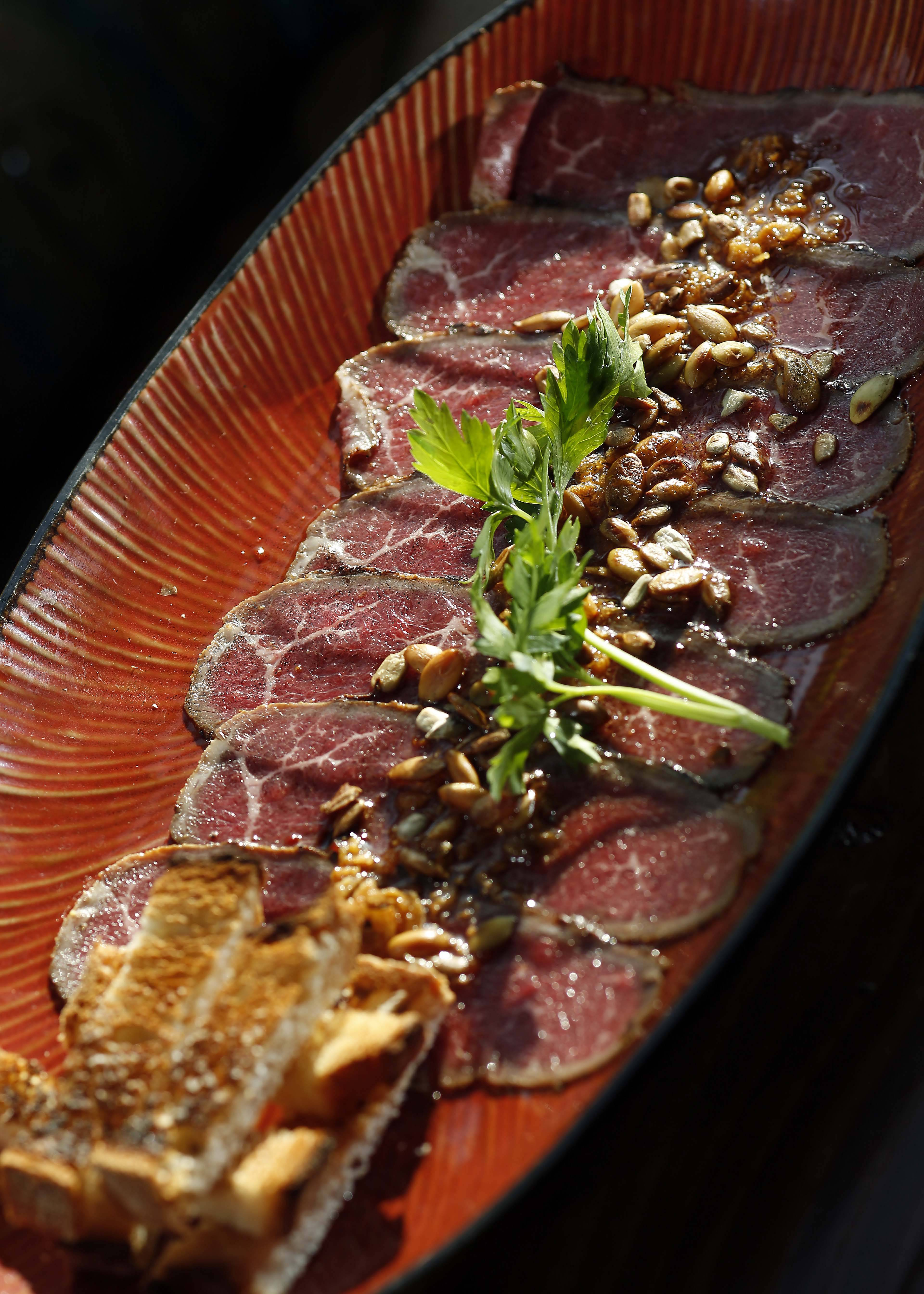Carpaccio Piccante, seared Kobe beef with pumpkin and sunflower seeds, is among the appetizers available at Gaetano's in Batavia.