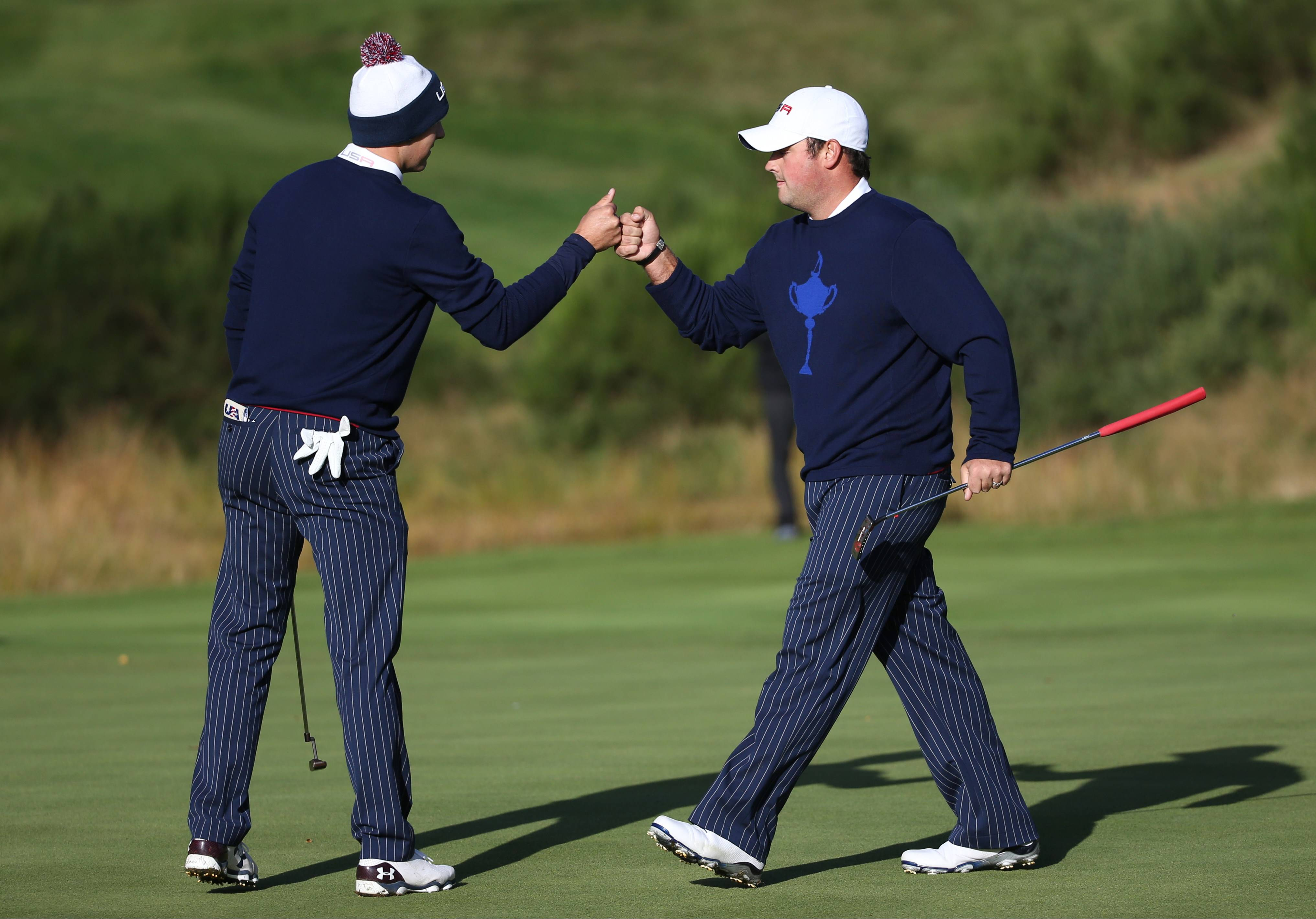 Jordan Spieth, left, and Patrick Reed, right, of the U.S. celebrate on the 6th green Friday during the fourball match on the first day of the Ryder Cup at Gleneagles, Scotland.