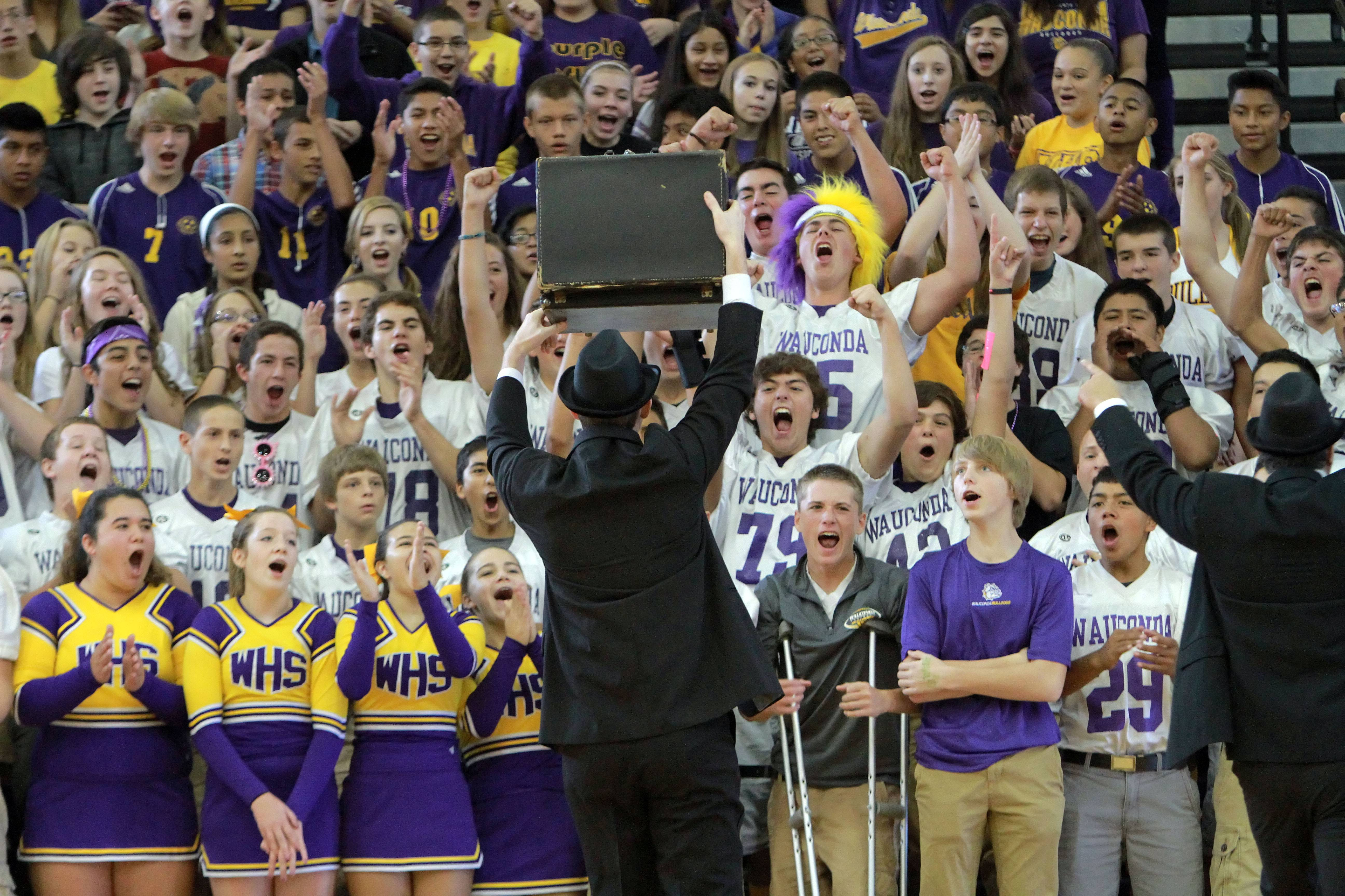 Math teacher Greg Dorgan gets the crowd revved up as he plays the role of Elwood Blues during a homecoming assembly Friday at Wauconda High School.