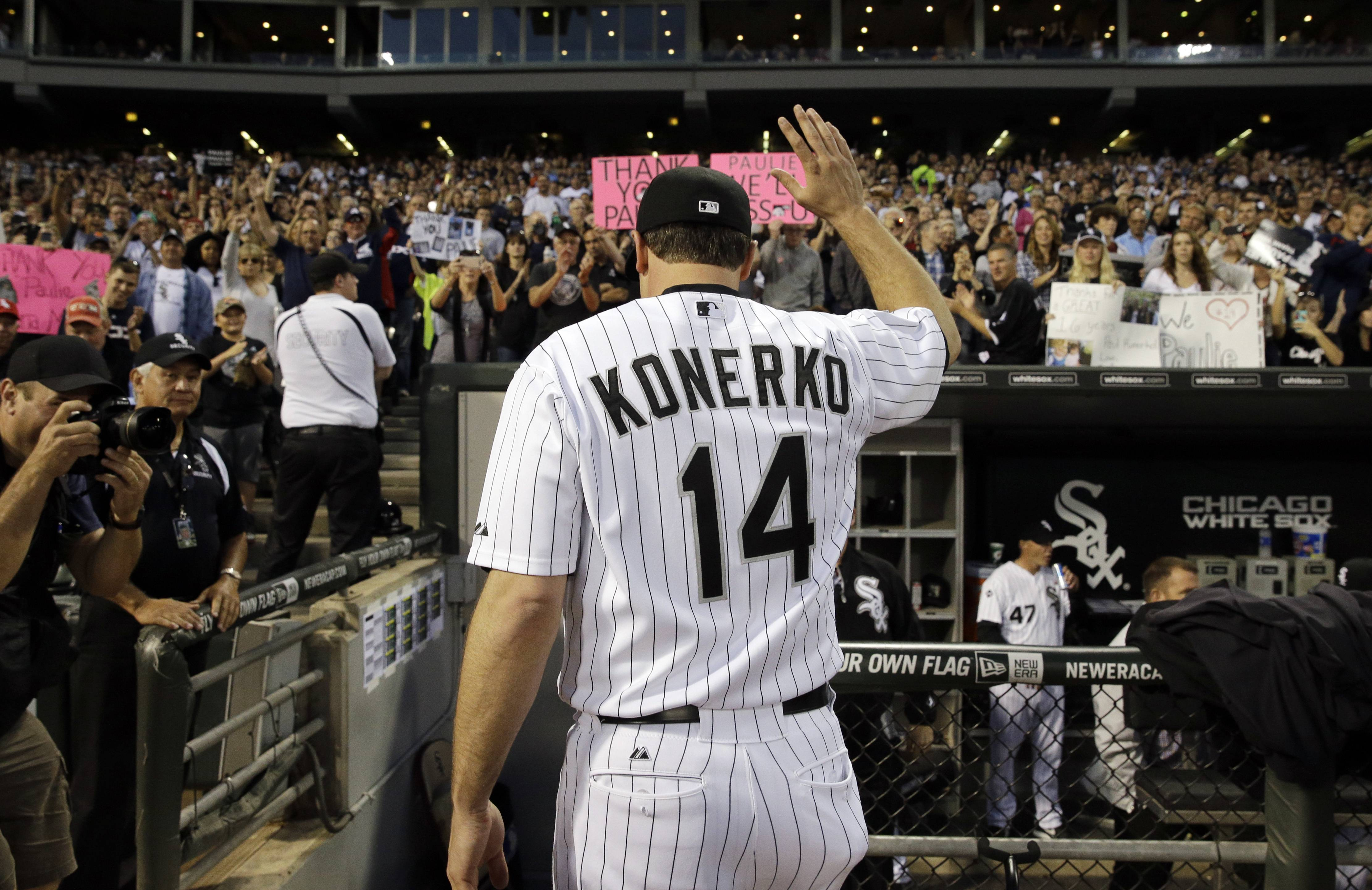 Chicago White Sox's Paul Kornerko (14) waves to the crowd as he walks to the dugout before a baseball game Saturday against the Kansas City Royals in Chicago.