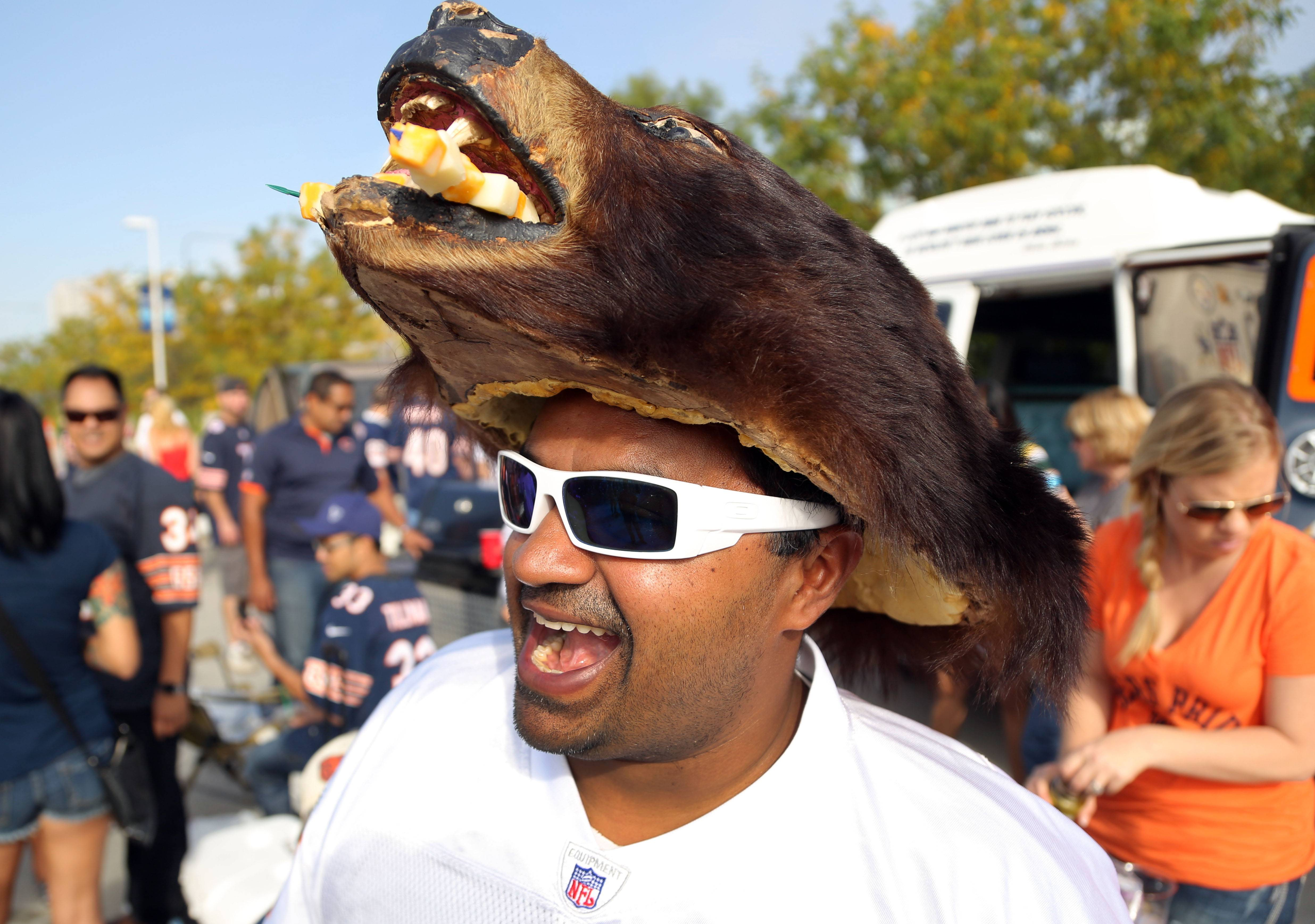 Sal Kahan of Naperville has cheese stuffed into the mouth of his bear hat prior to the Bears Packers game Sunday at Soldier Field in Chicago.