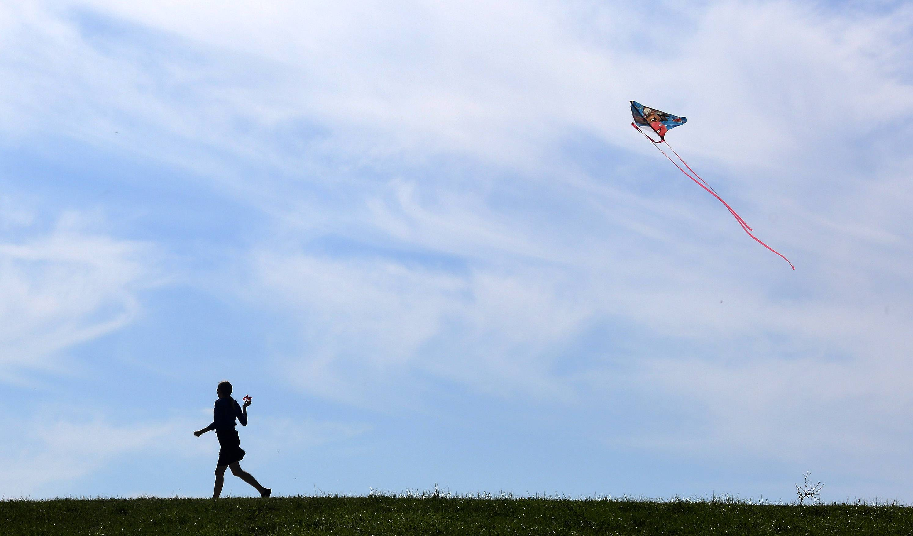 Joyce West, of Antioch, flies a kite during Family Kite Flying Day Sunday at Tim Osmand Sports Complex in Antioch. The first 50 children received free kites at the Antioch Parks and Recreation Department event.