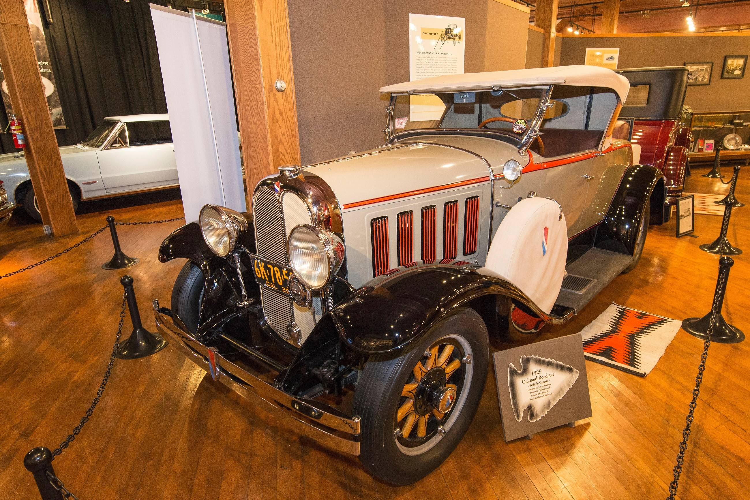 A 1929 Oakland Roadster is on display. The Oakland Motor Car Co. made vehicles in Pontiac, Michigan. It later became the Oakland Motors Division of GM.