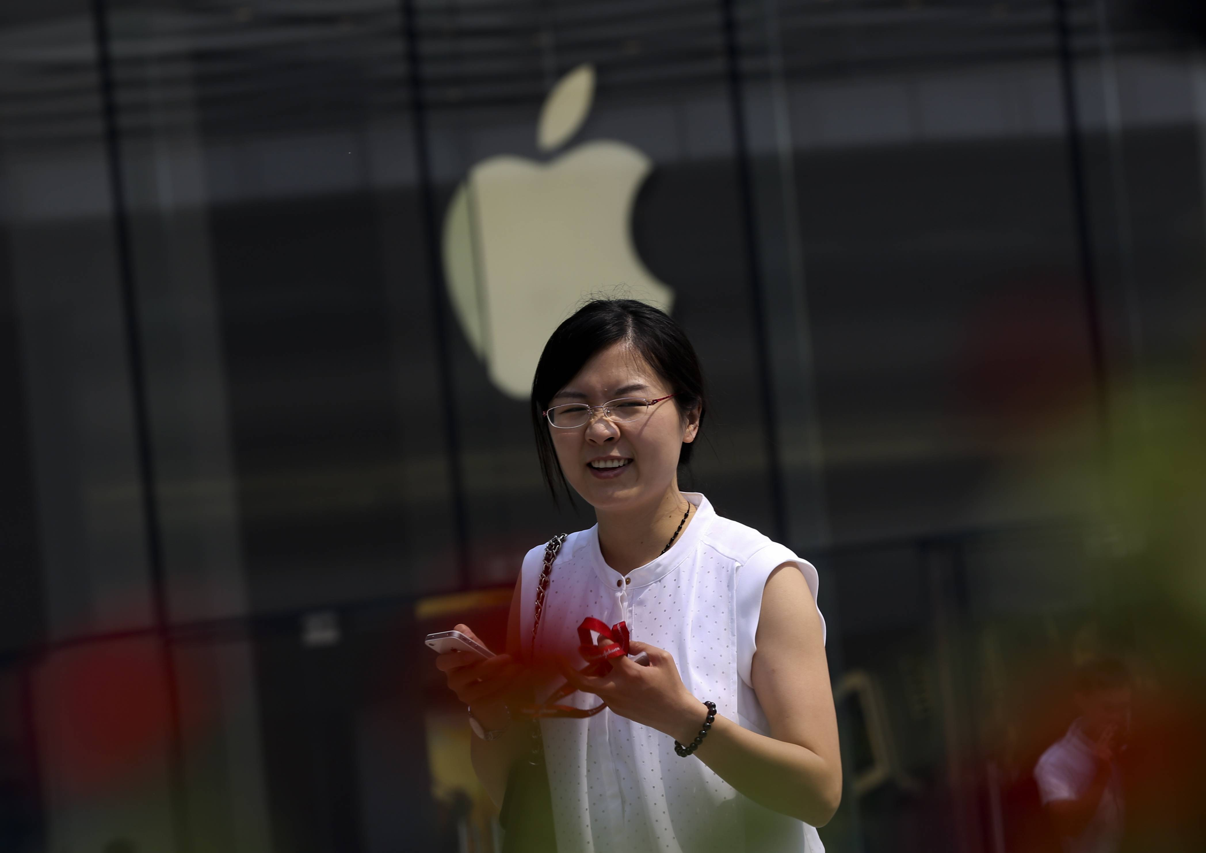 China's phone regulator said Tuesday it has approved Apple Inc.'s iPhone 6 for use on Chinese networks after the company promised never to allow other governments access to users' information. Apple said sales start on Oct. 17.