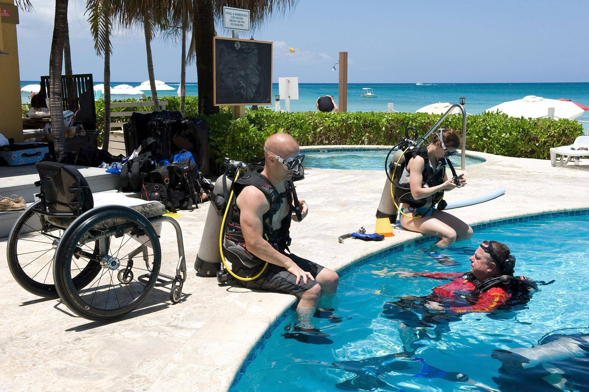 Chris Kaag, paralyzed by a rare disorder, and his wife, Gretchen, get training from scuba instructor Bill Monsam. The condition of Kaag and others in a small study improved greatly after just five days of scuba diving.