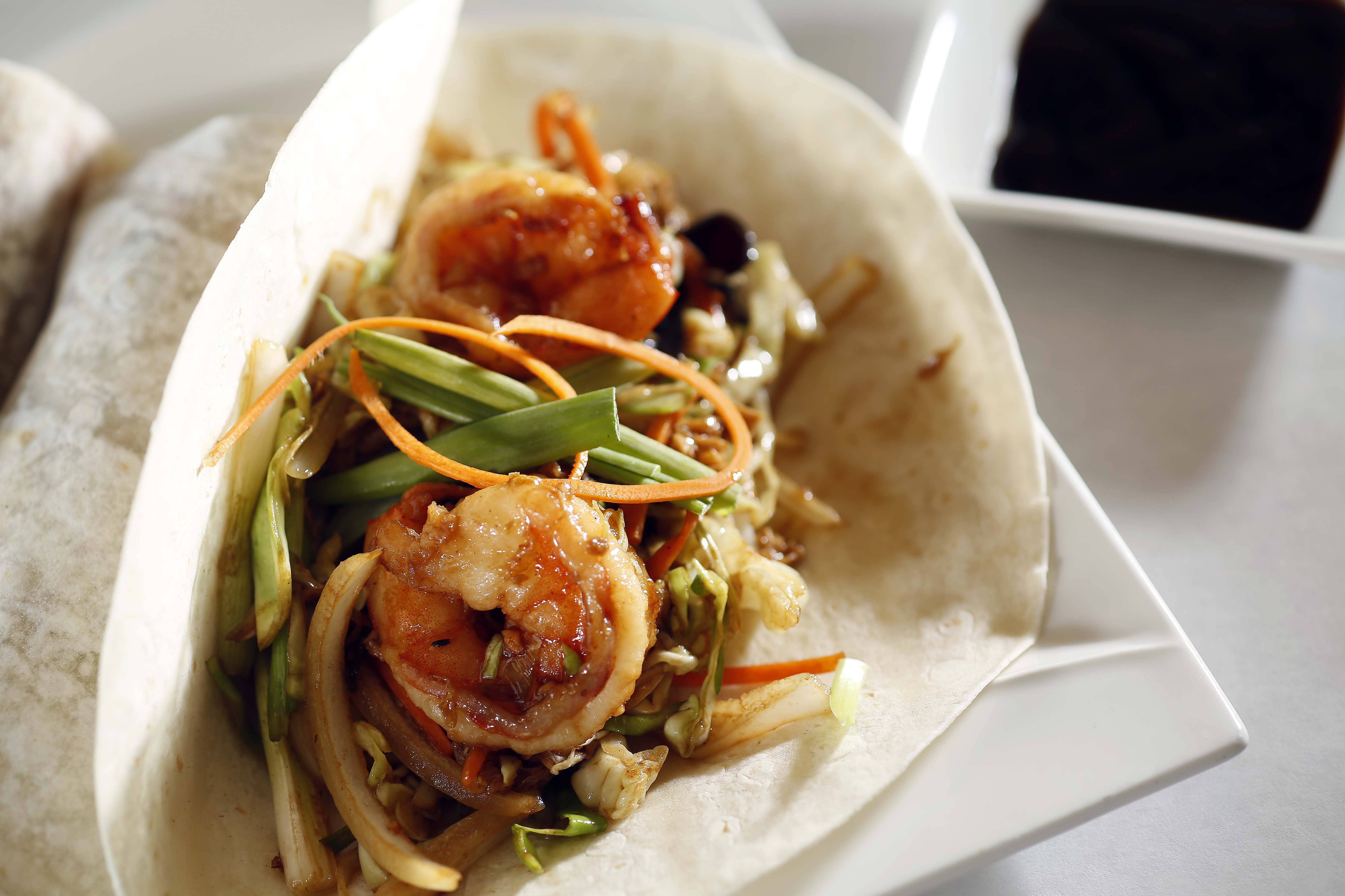 Four jumbo shrimp are tucked into crepe-like wraps at Liu Brothers Asian Bistro in St. Charles.