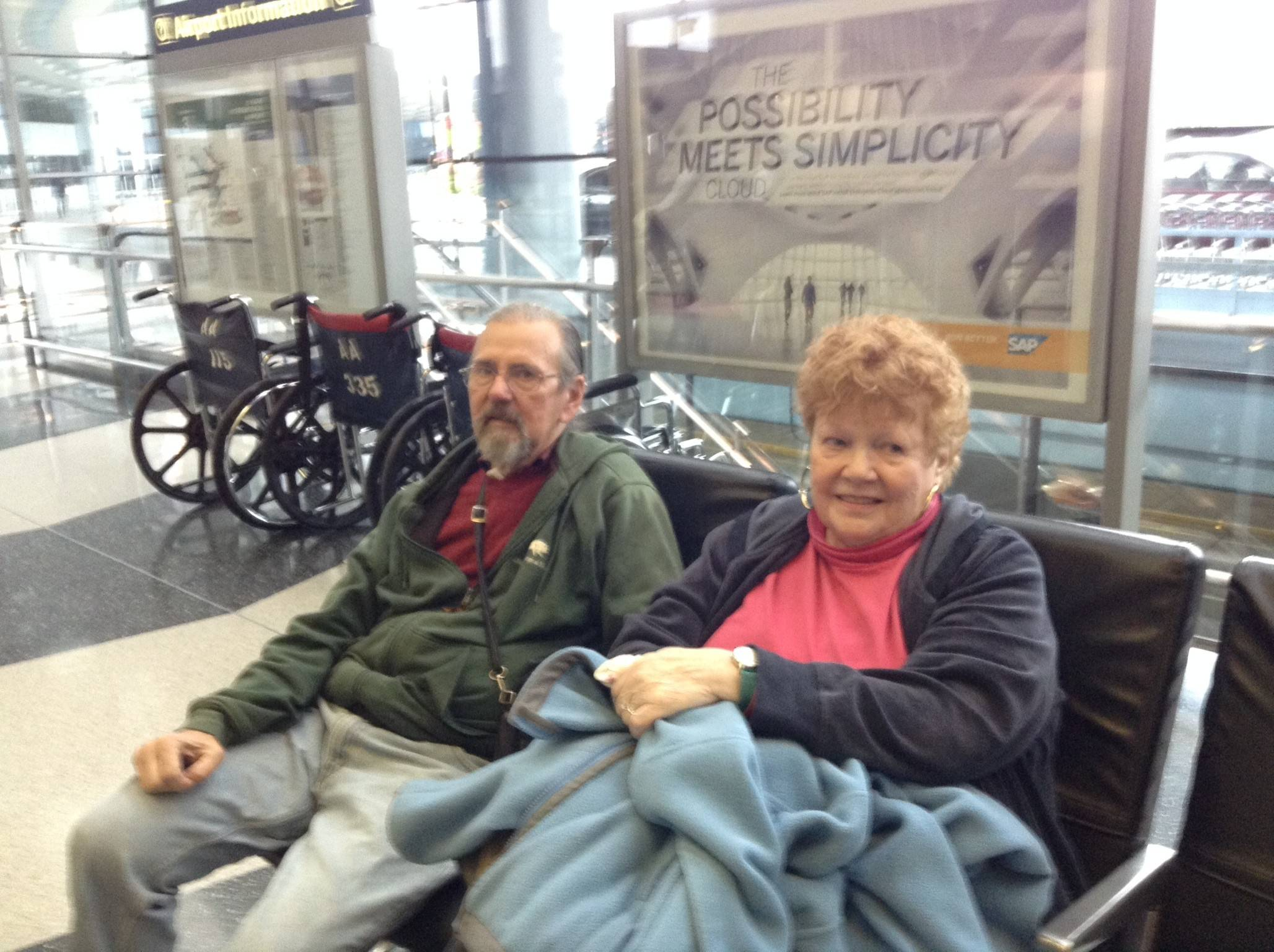 Jackie and Art Skwerski of Oak Park wait at O'Hare International Airport. Their flight was on time Tuesday.