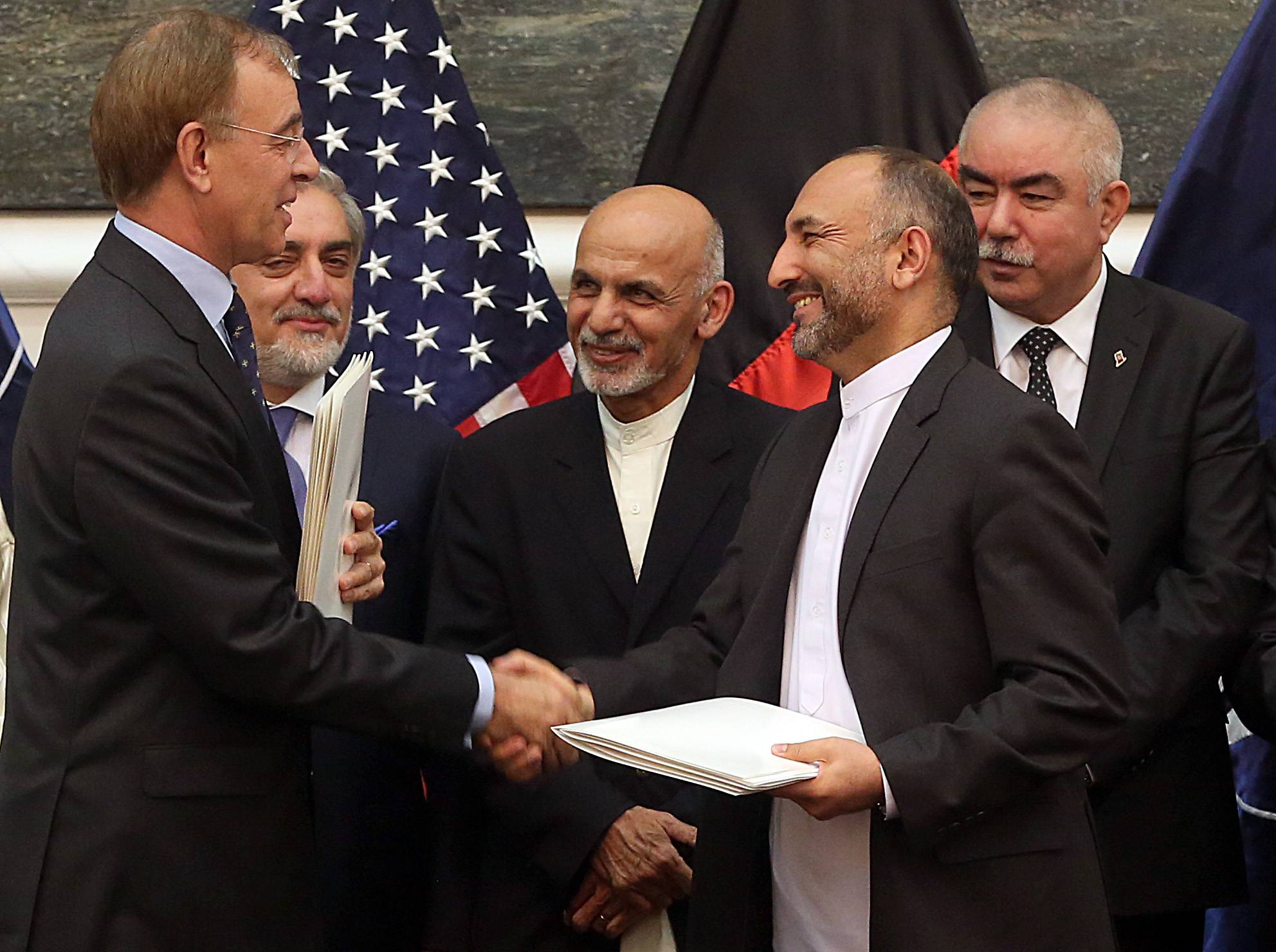 Afghanistan and the United States signed a long-awaited security pact on Tuesday that will allow U.S. forces to remain in the country past the end of year.