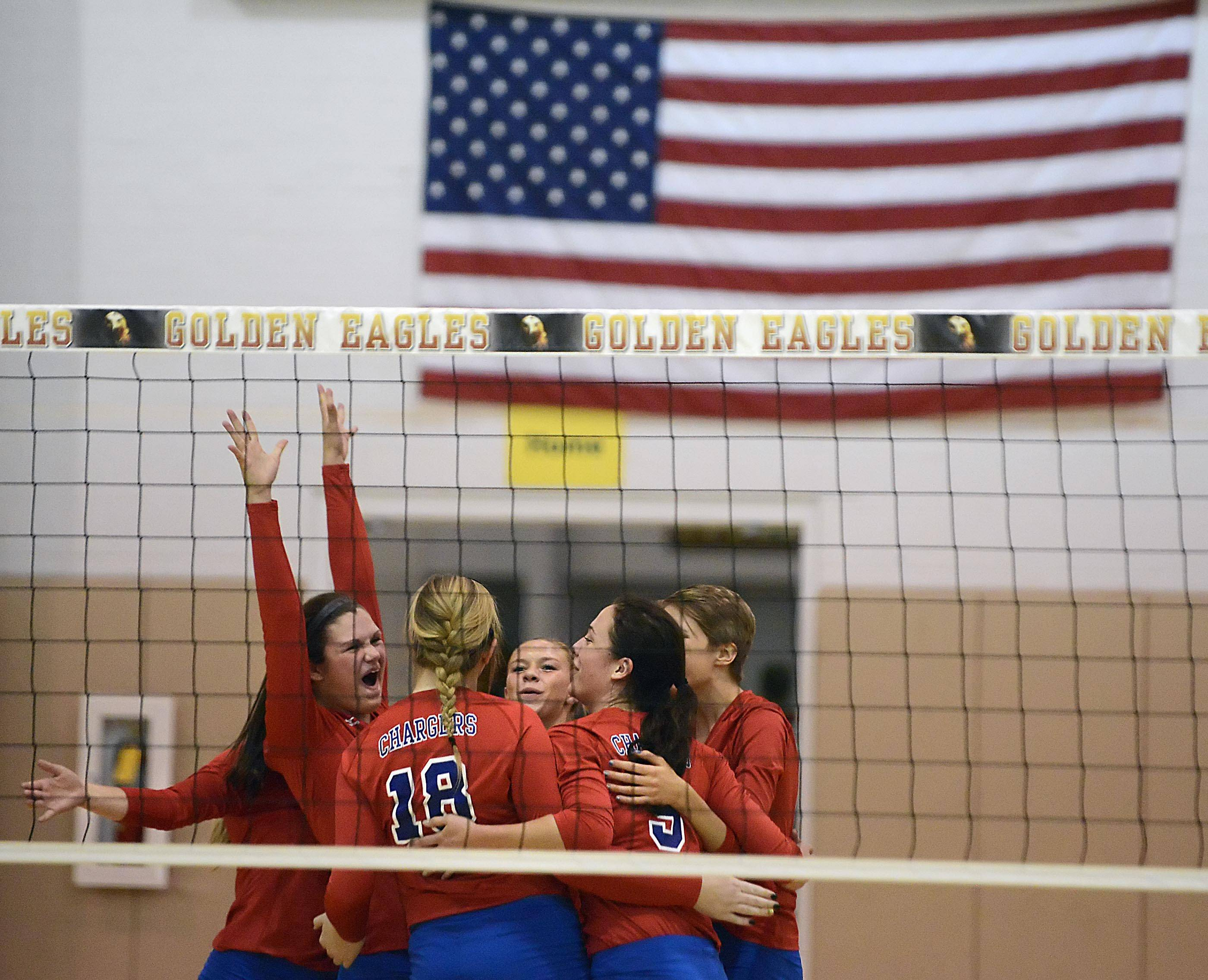 Dundee-Crown celebrates a point against Jacobs Thursday in Algonquin.