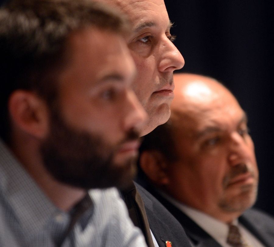 Illinois Charter School Commission members, from left, Bill Farmer, Greg Richmond and Rudy Valde, listen during a public hearing on a charter school proposal Tuesday night at Larkin High School in Elgin.