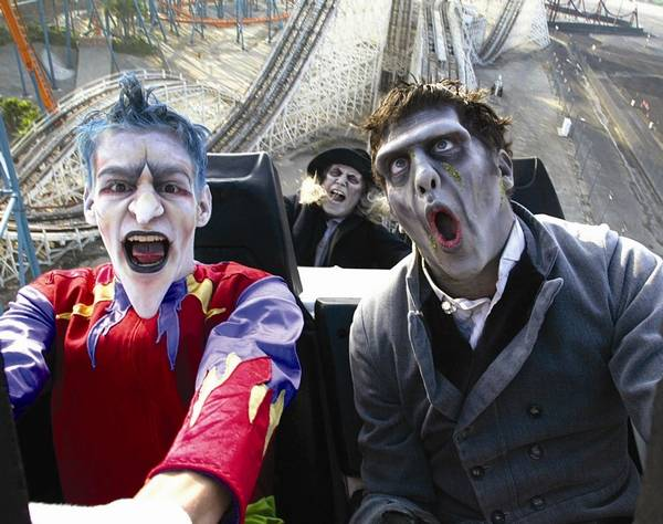 ghouls ride a roller coaster at six flags great america for fright fest in gurnee