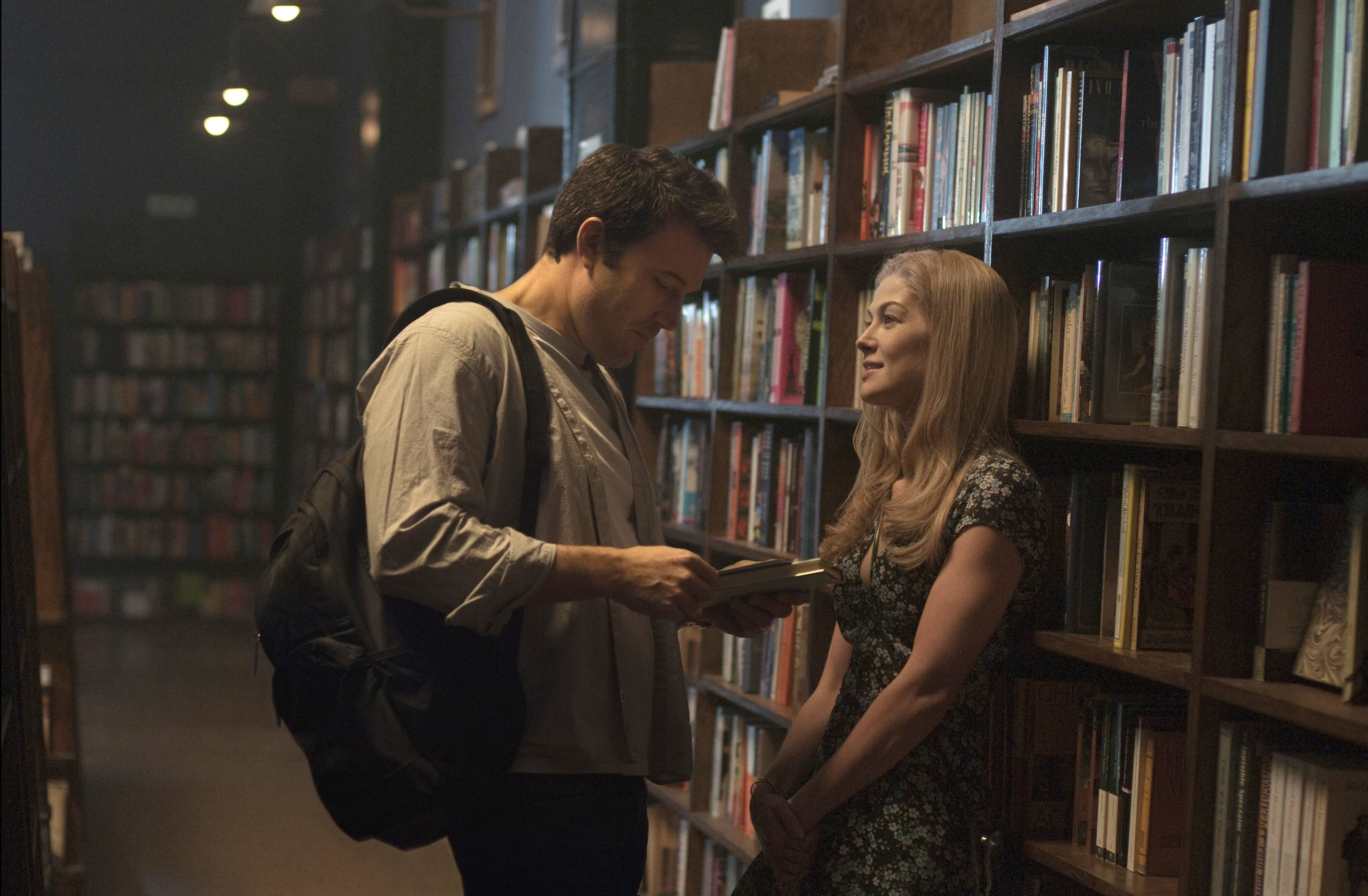 "Ben Affleck and Rosamund Pike appear in a scene from ""Gone Girl."" The film, based on the best-selling novel, took the No. 1 spot at the box office, narrowly edging out the horror film ""Annabelle."""