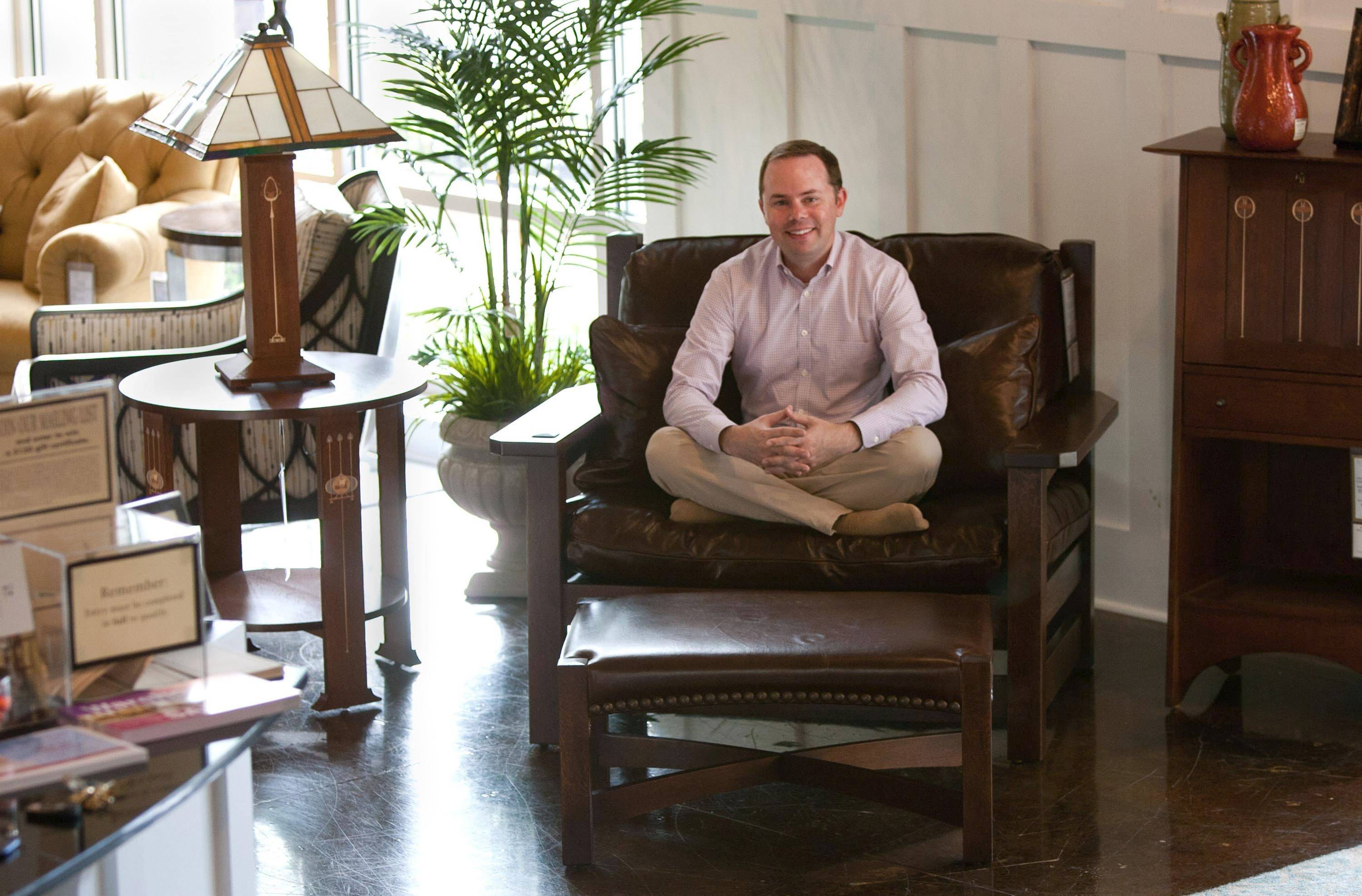 Scott Price, An Owner Of Toms Price, Shows A Replica Of The Chair