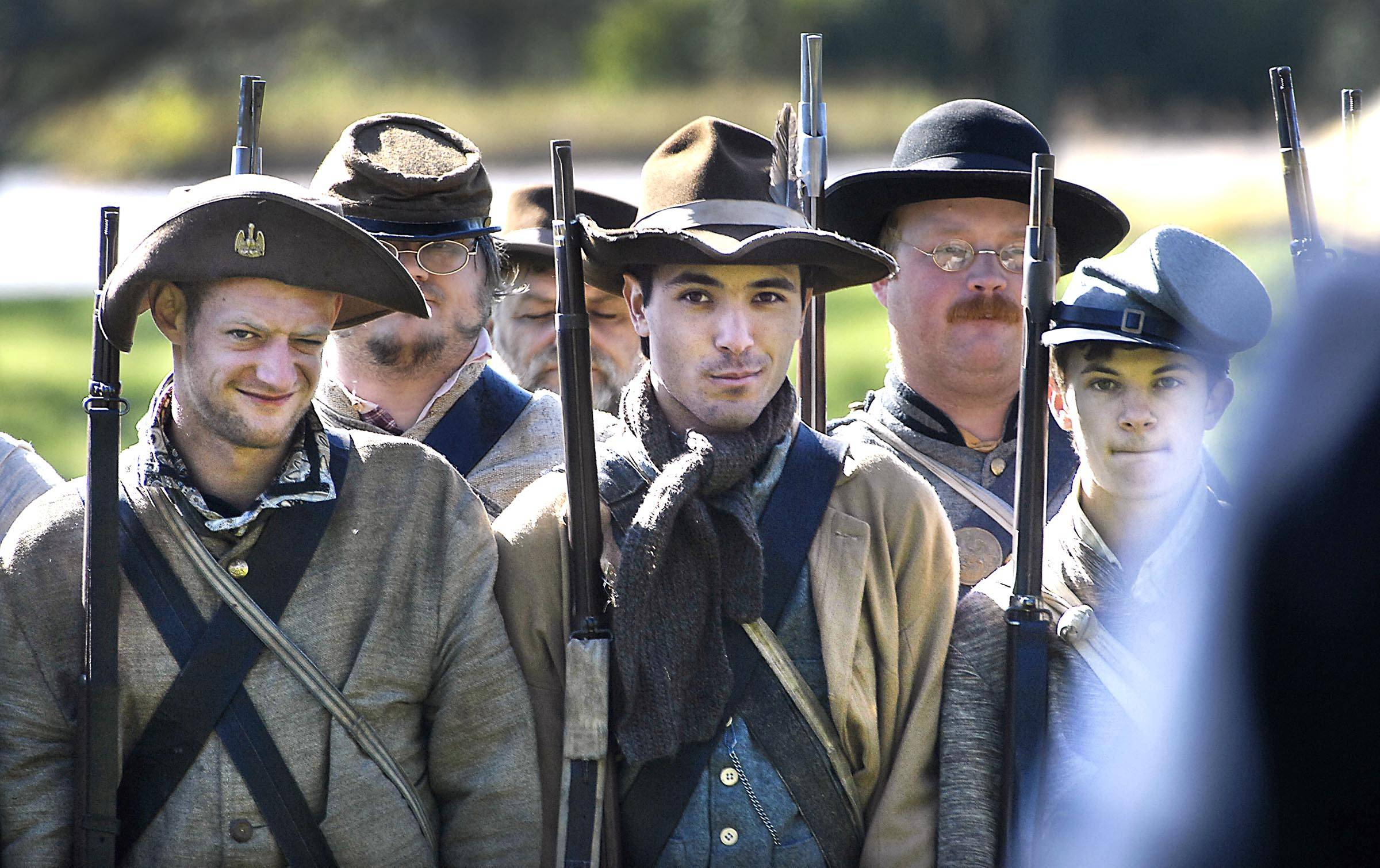 Confederate re-enactors stand in formation Sunday at a Civil War re-encampment at Cantigny Park in Wheaton.