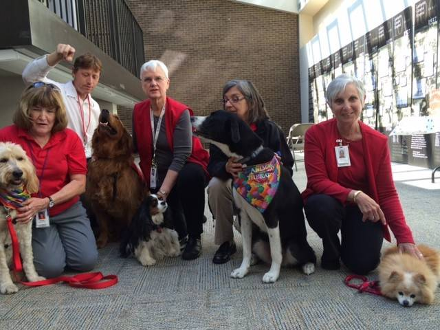 From left: Pat Lawler and Colleen, Gary Marchessault and Einstein, Susan Burrows and Abbey, Barb Alla and Charlie, and Gayle Levine and Buddy.