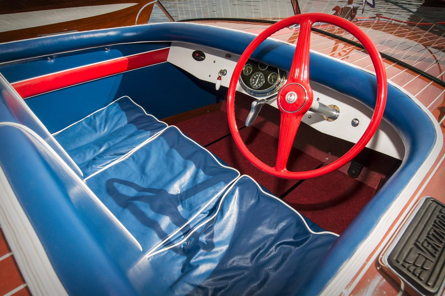 The boat's sides, keel, dashboard and hardware are original.