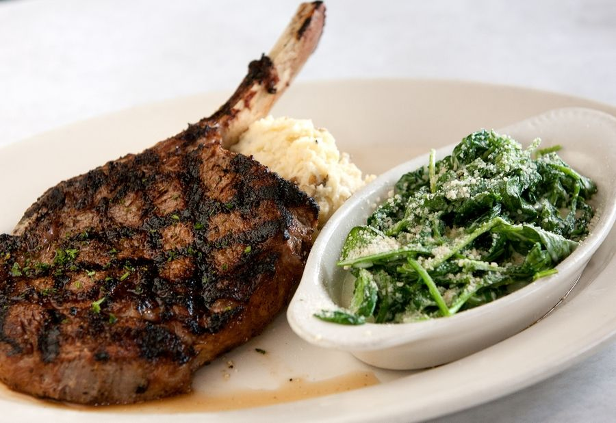 Bone-in rib-eye and creamed spinach make an awesome duo at Walker's Charhouse in Naperville.
