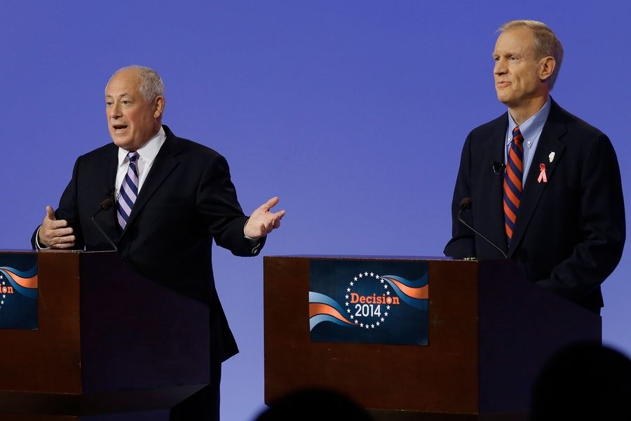 Democratic Gov. Pat Quinn, left, answers questions while debating Republican gubernatorial candidate businessman Bruce Rauner, right, Thursday in Peoria.