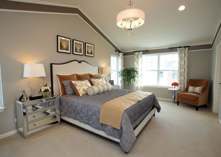 The master bedroom in the Summit model has a vaulted ceiling and chandelier.