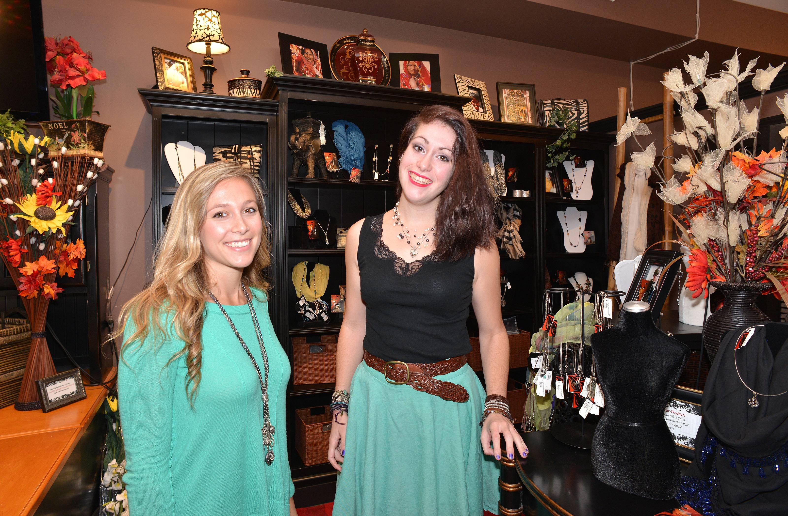 Jessie Dattalo of Wheaton, left, and Meggie Zayas of Lombard are shown in the WAR Chest Boutique in Naperville. Everything in the store is made or sourced from victims of human trafficking or those at risk for human trafficking around the world.