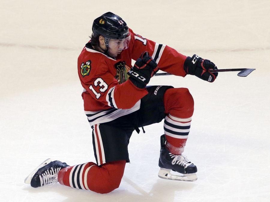 Blackhawks left wing Daniel Carcillo celebrates after scoring a goal during the third period Saturday night. The Hawks defeated the Buffalo Sabres 6-2.