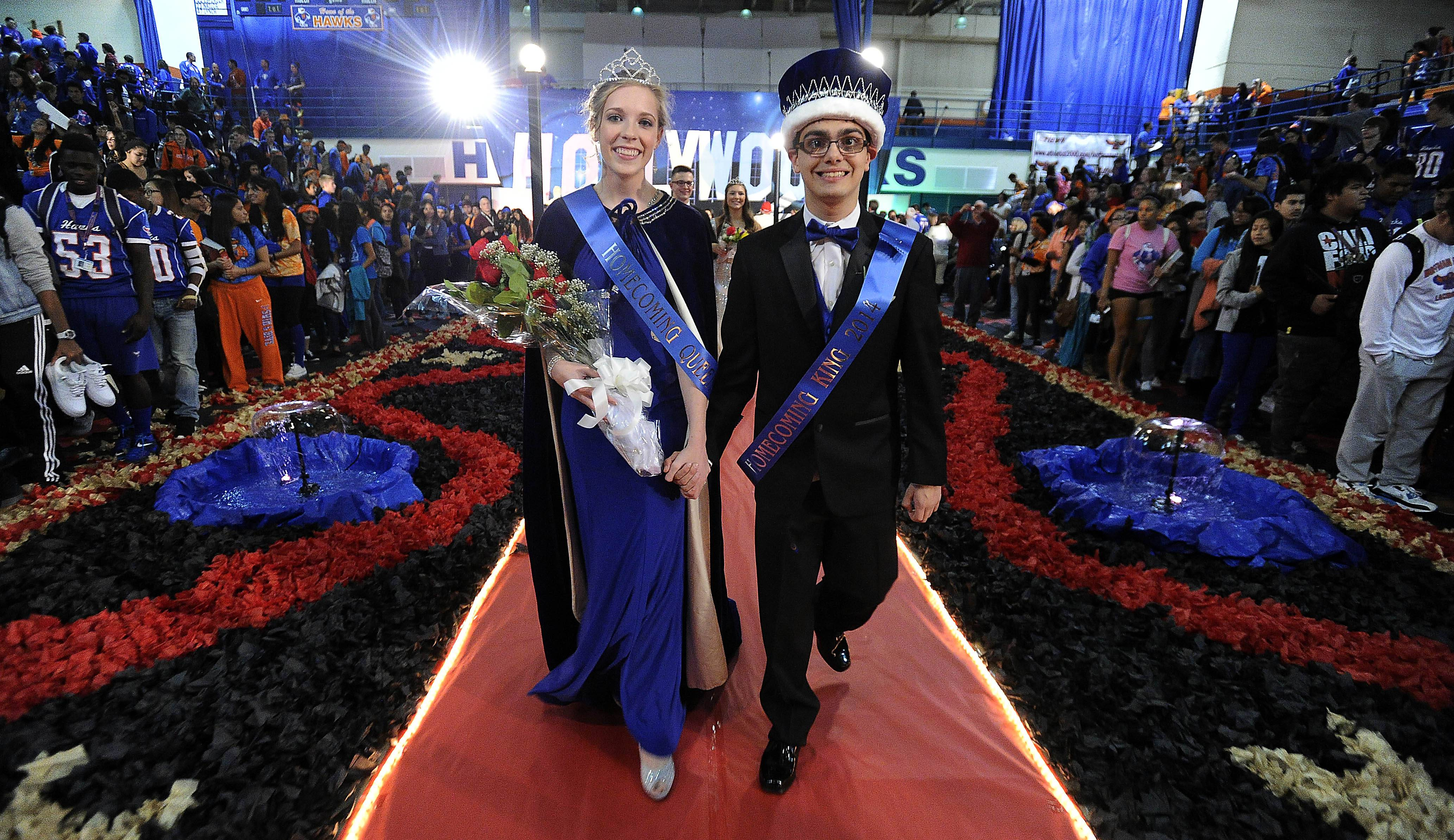 A. J. Pilafas, a special education student at Hoffman Estates High School, celebrates his sweet victory of being selected as homecoming king at a ceremony at Hoffman Estates High School on Friday. Next to him is the queen, Hannah Greenwalt.