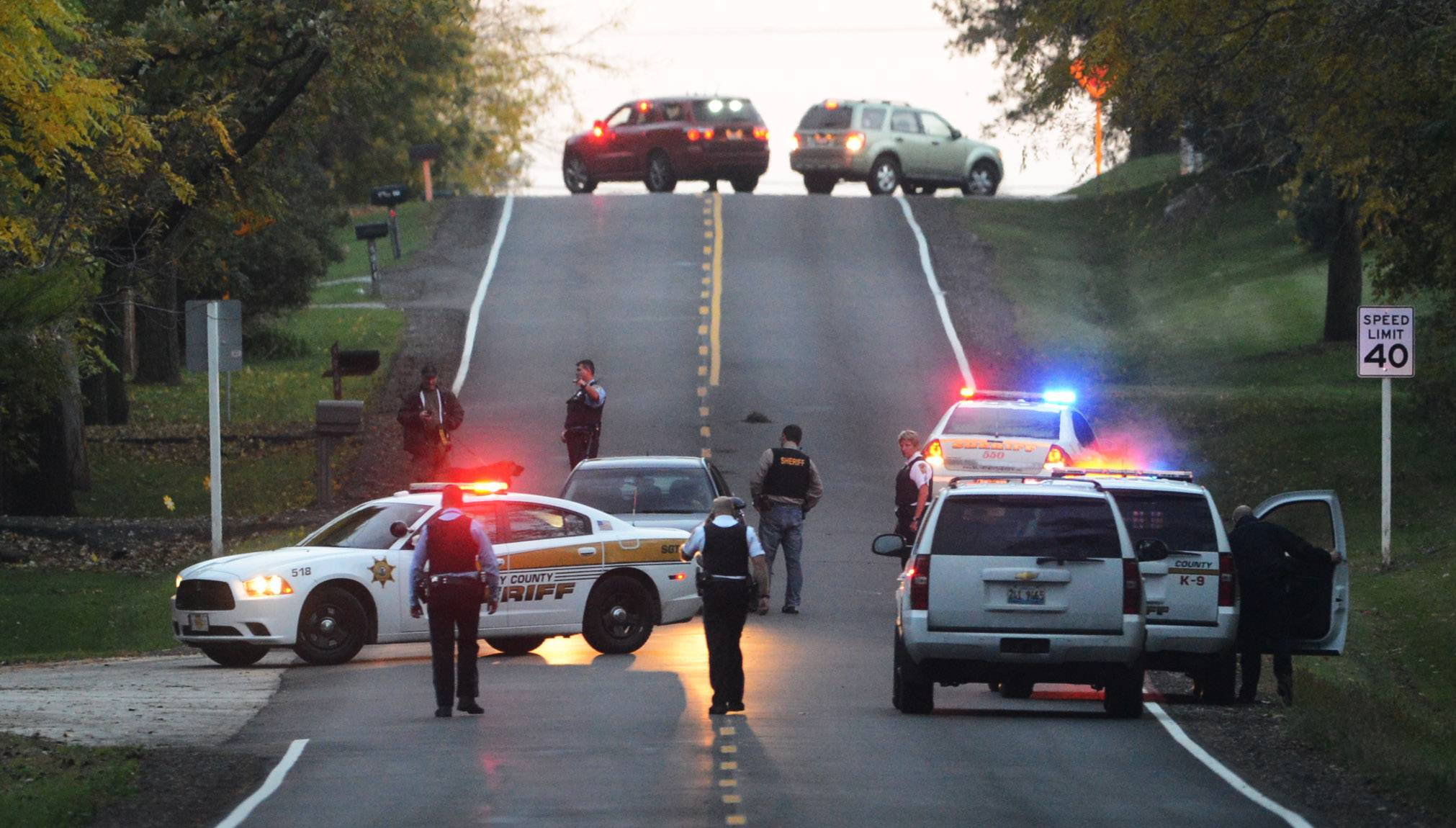 Images: Holiday Hills Shooting Suspect Manhunt
