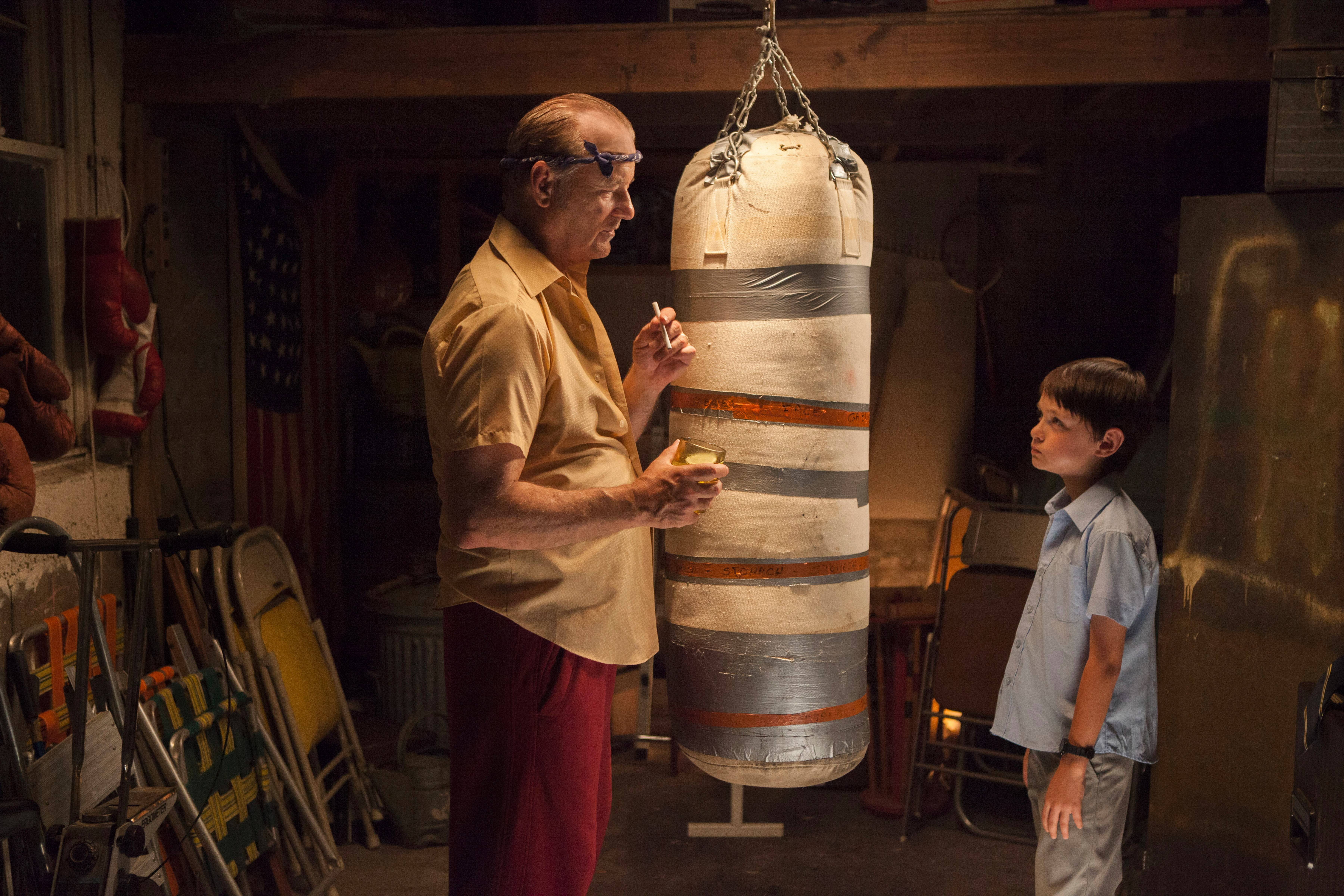 Vincent (Bill Murray) teaches Oliver (Jaden Lieberher) how to deliver a decent right hook in St. Vincent. Credit: www.dailyherald.com