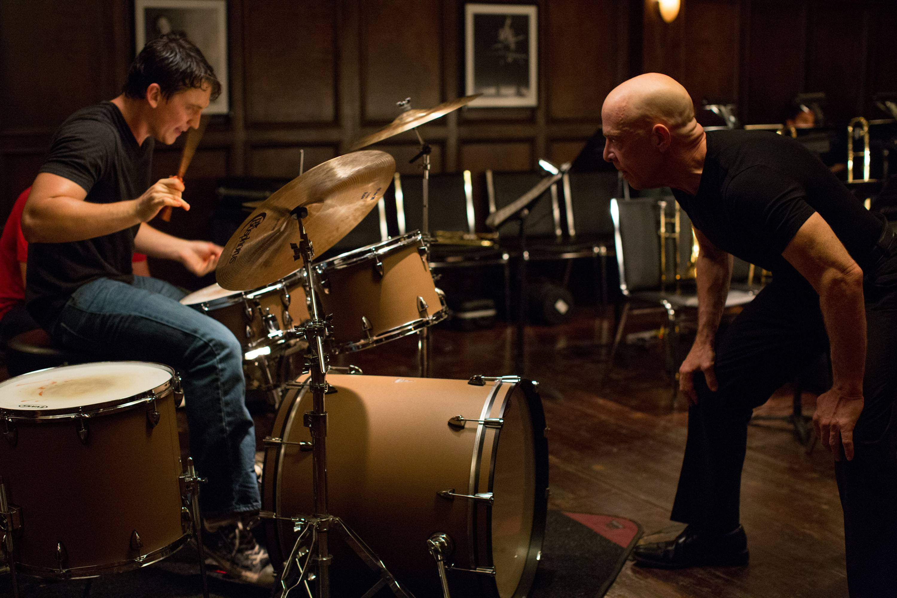 "Andrew (Miles Teller), left, is driven to the edge by an obsessive band conductor (J.K. Simmons) in the drama ""Whiplash."""