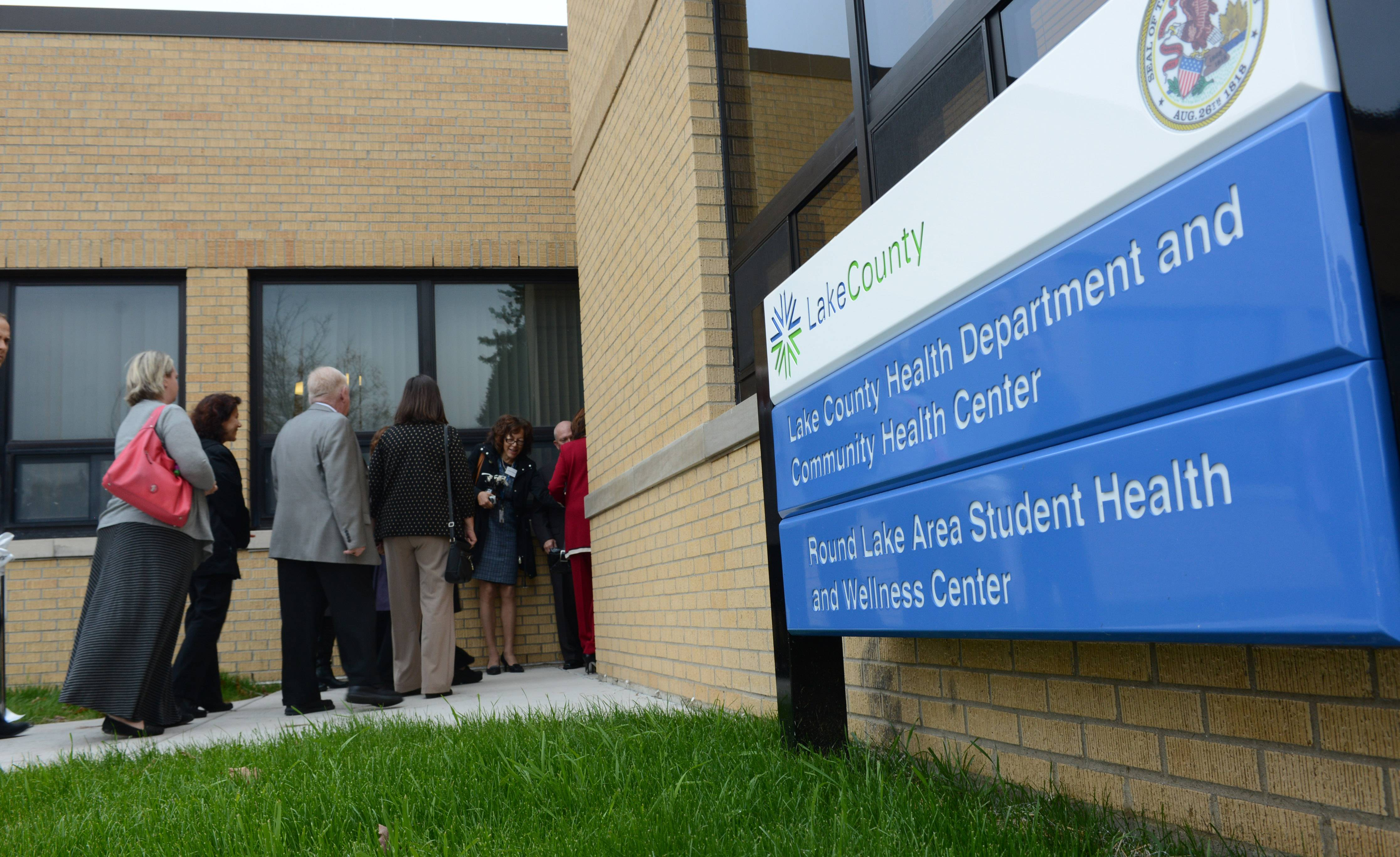 Officials head inside for a tour of the new Round Lake Area Student Health and Wellness Center on Thursday folliowing a ribbon cutting.