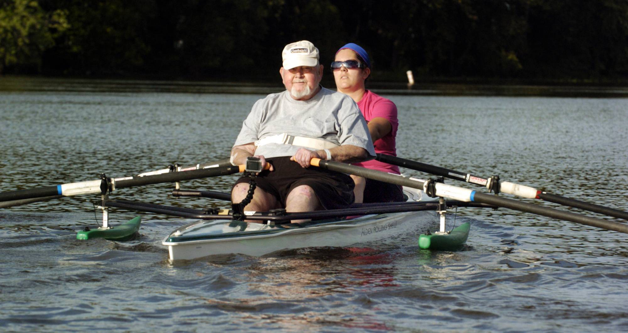 Hope Creek Care Center's rehabilitation patient, 72-year-old Tom Sisson fulfills a childhood dream by learning to scull a boat as he rows with instructor and Hope Creek physical therapist Nicole Taylor from Aledo in the waters of the Mississippi River near the Sylvan Boathouse in Moline.