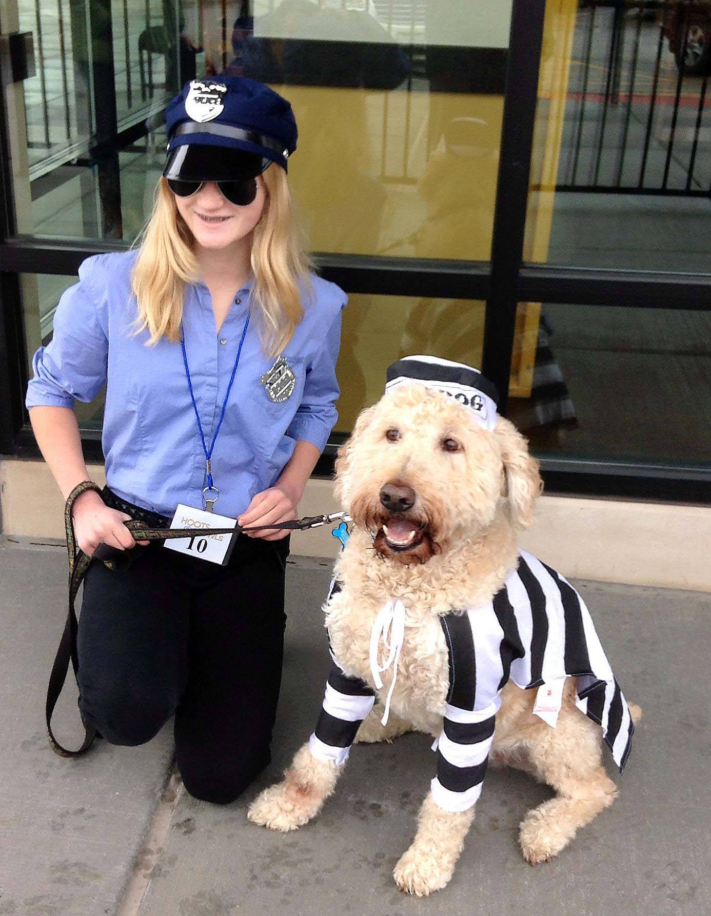 This good cop and bad dog took top honors in a pet parade costume contest Saturday at Randhurst Village in Mount Prospect. Megan McNally, 13, of Arlington Heights said her dog, Cody, makes a perfect prison inmate.