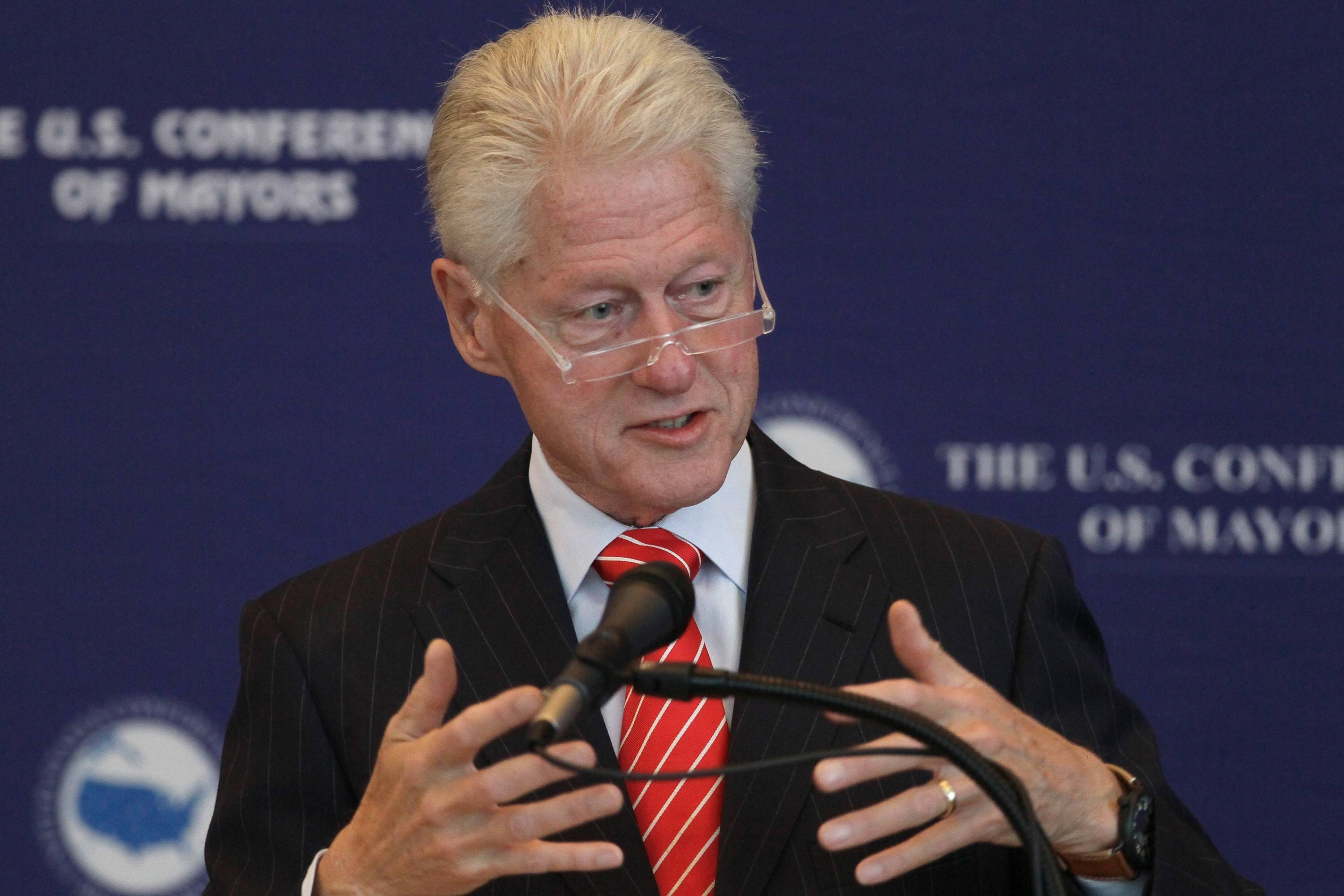 Former President Bill Clinton speaks to a meeting of the U.S. Conference of Mayors at the Clinton Presidential Library in Little Rock, Ark., earlier this month. He'll be in Chicago Tuesday.