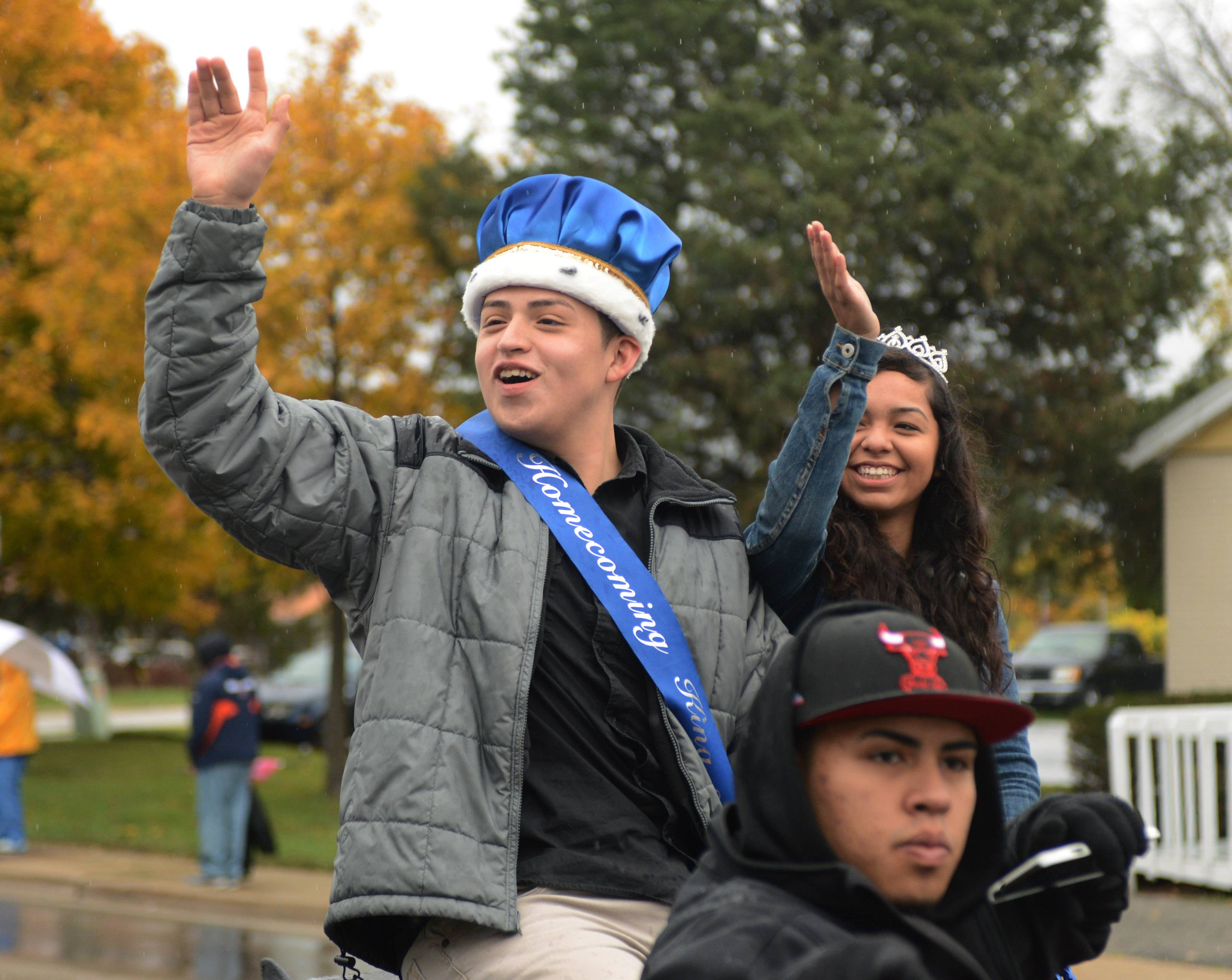 Round Lake High School's homecoming king Alsonso Herrera and queen Jenny Juarez, both 17 of Round Lake Park, ride in style during Saturday's homecoming parade down Cedar Lake Road.