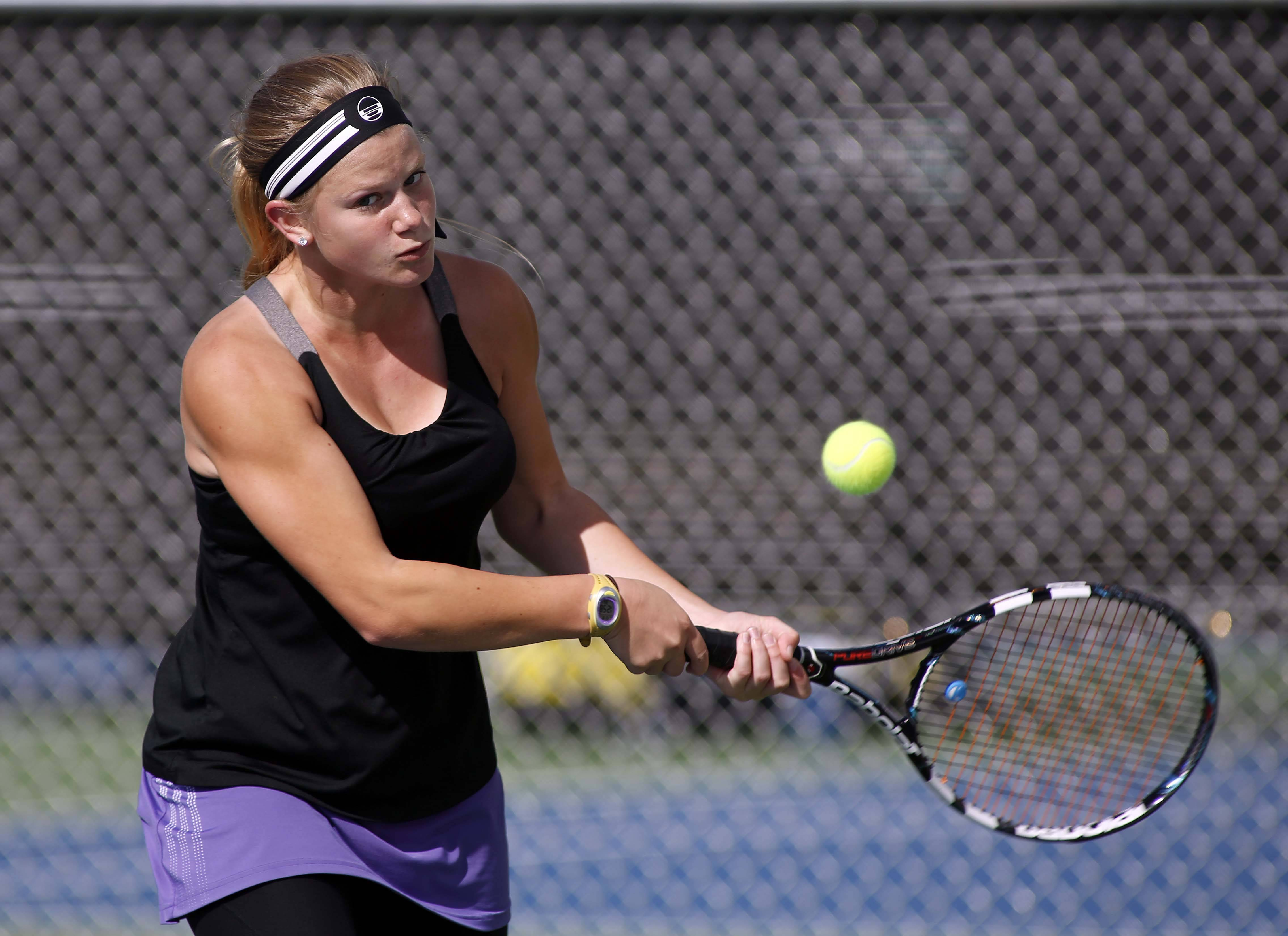 Hampshire's Hannah Hougland in singles action during the Huntley sectional Saturday.