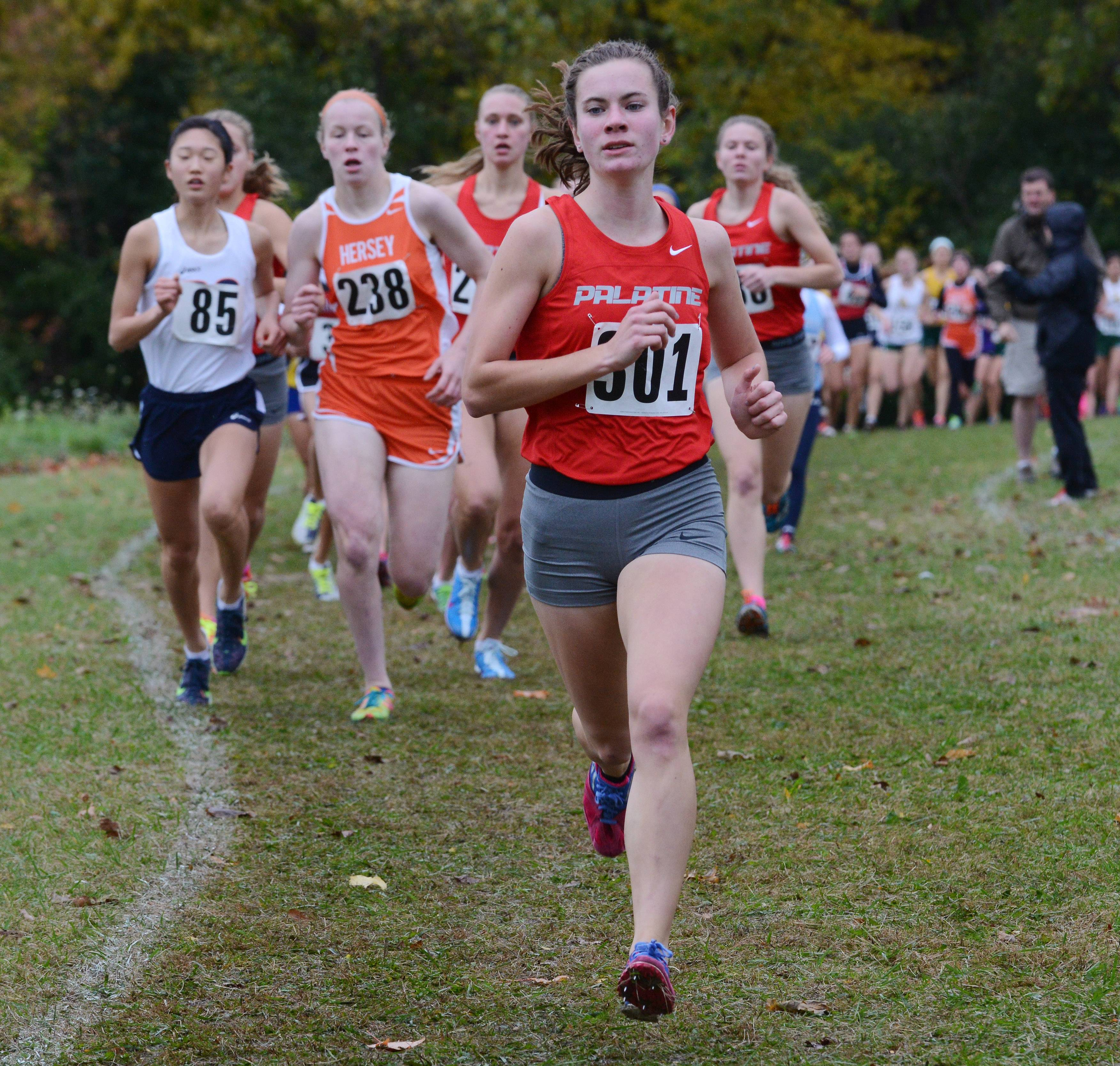 First-place finisher Kelly O'Brien of Palatine has the early during Saturday's Mid-Suburban League girls cross country meet at Busse Woods Forest Preserve.