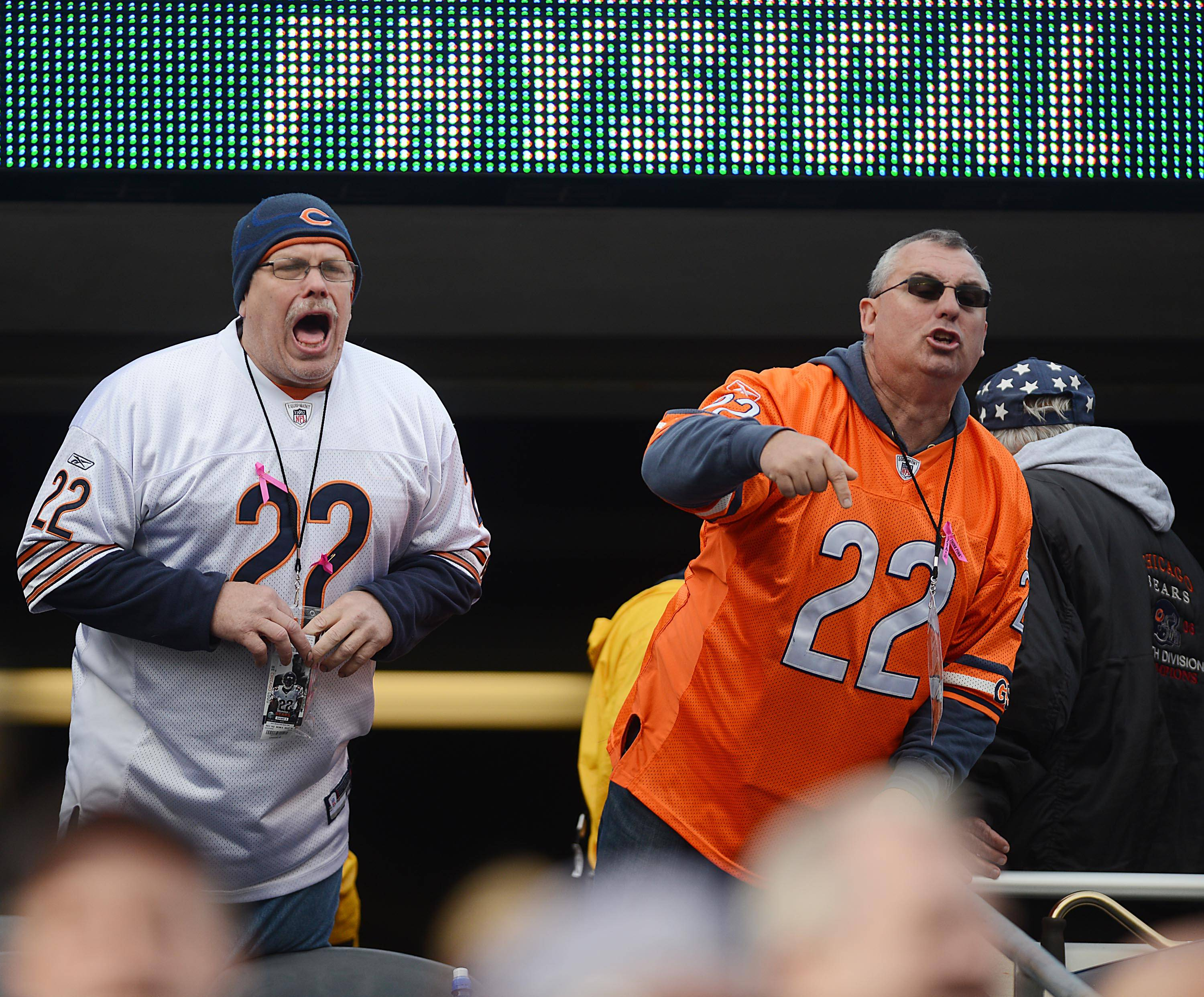 Two Chicago Bears fans scream at the team as they leave the field after losing to the Miami Dolphins Sunday at Soldier Field in Chicago.