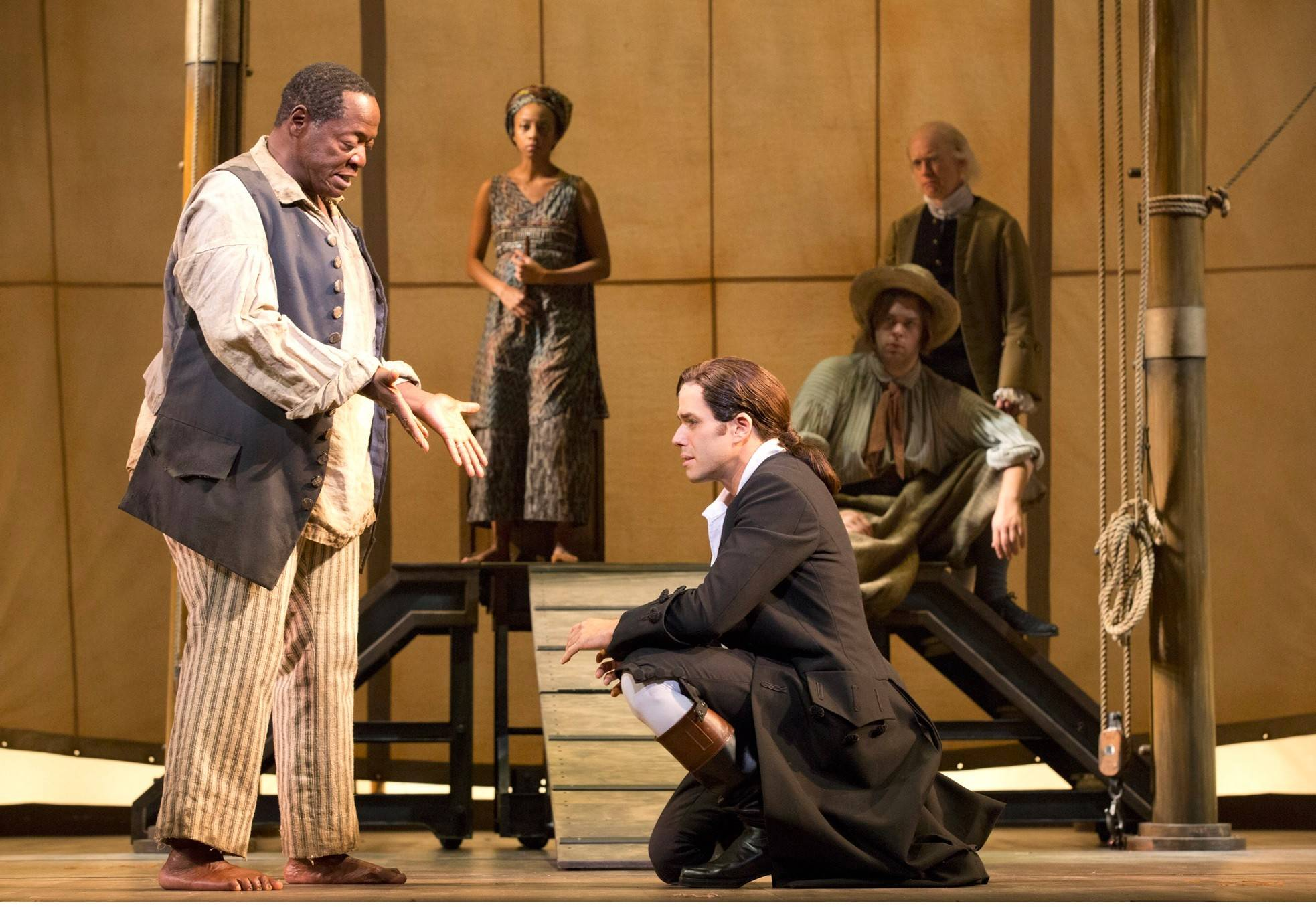 "On the road to redemption, John Newton (Josh Young, kneeling) asks forgiveness from Thomas (Chuck Cooper) in the musical ""Amazing Grace"" by Christopher Smith, in its world premiere at the Bank of America Theatre."