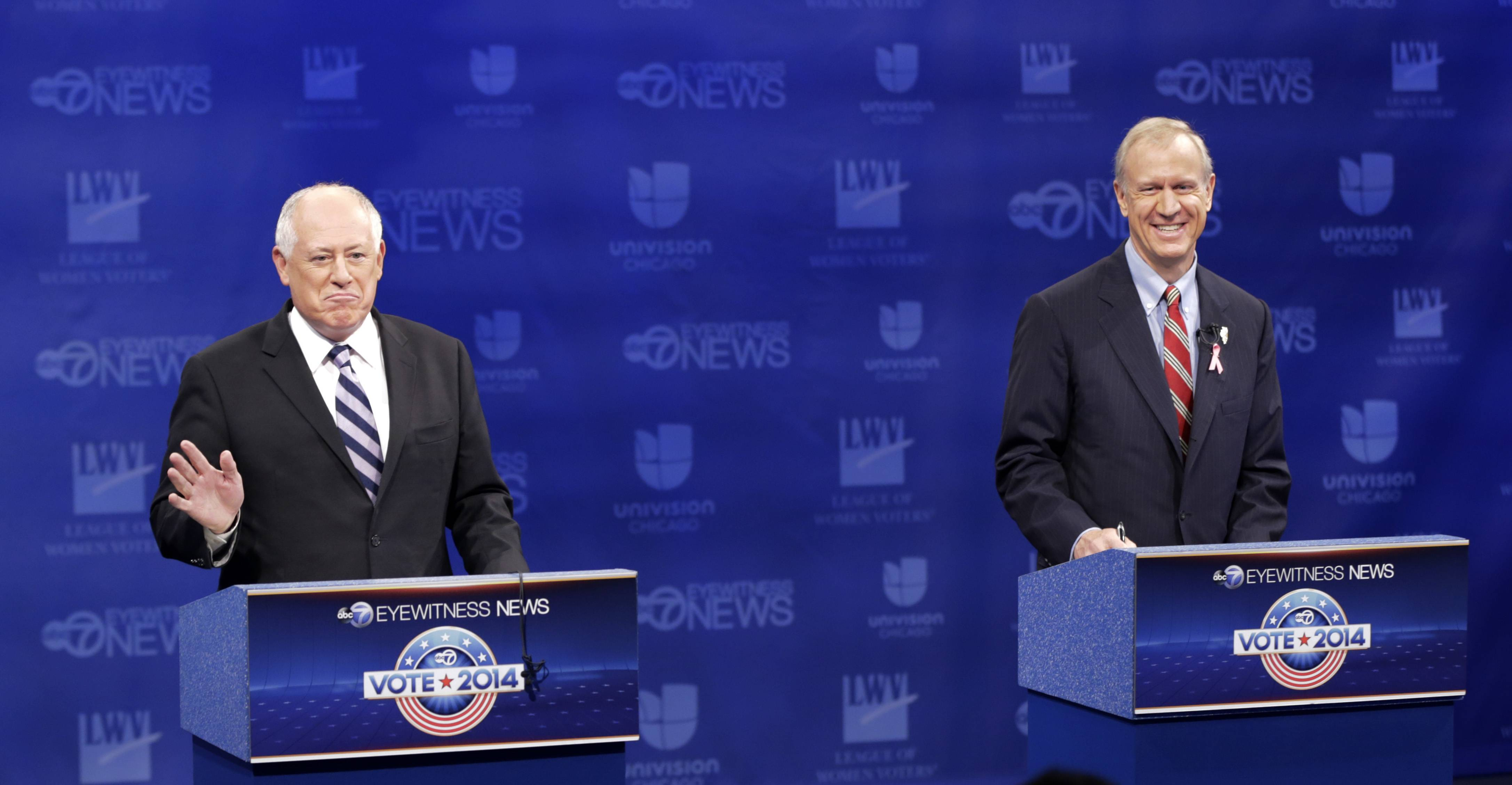 Illinois gubernatorial candidates Republican Bruce Rauner, left, and Democrat Gov. Pat Quinn greet before a debate at the DuSable Museum of African American History, Tuesday, Oct. 14, 2014, in Chicago. The debate is expected to focus on black voters. (AP Photo/Charles Rex Arbogast)