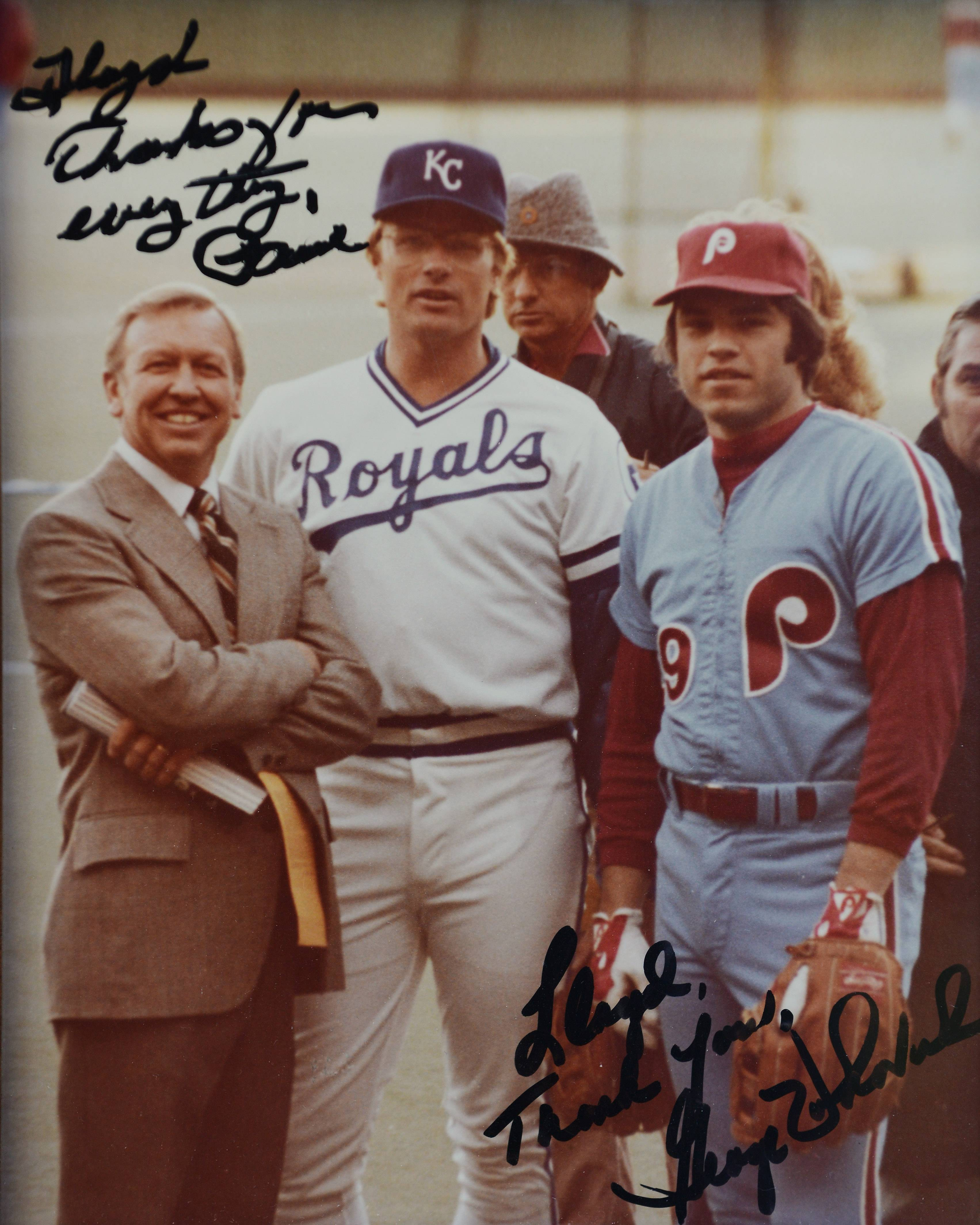 Lloyd Meyer cherishes this photo of himself, left, with Paul Splittorff, center and George Vukovich of the Phillies, taken during the 1980 World Series.
